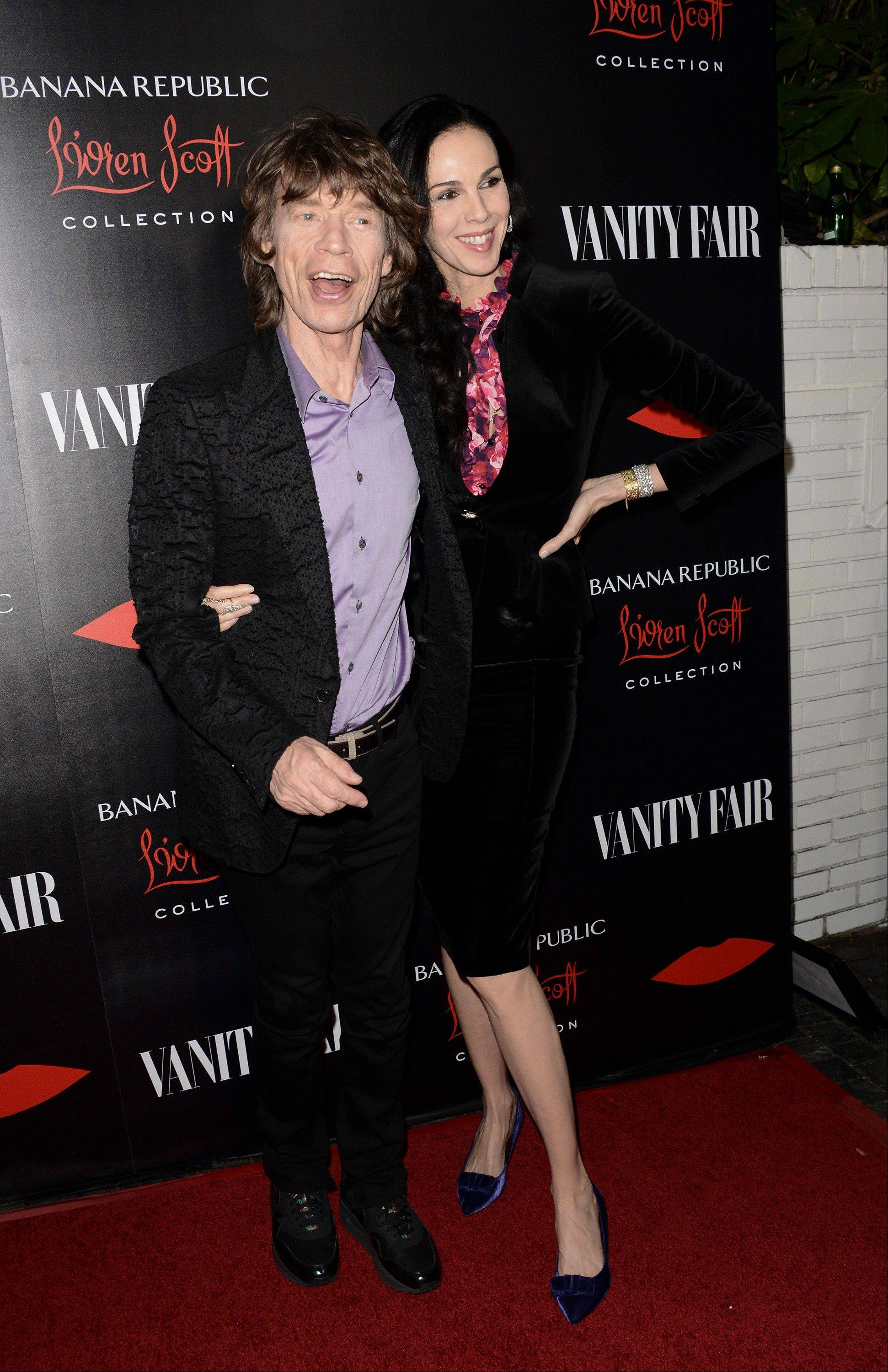 Mick Jagger and fashion designer L�Wren Scott arrive at the Banana Republic L�Wren Scott Collection launch party Tuesday at the Chateau Marmont in West Hollywood, Calif. L�wren Scott, who launched the limited-edition Banana Republic L�Wren Scott Collection Wednesday, says it will wrap her signature flattering construction and extraordinary fabrics into a package that will cost less than $200.