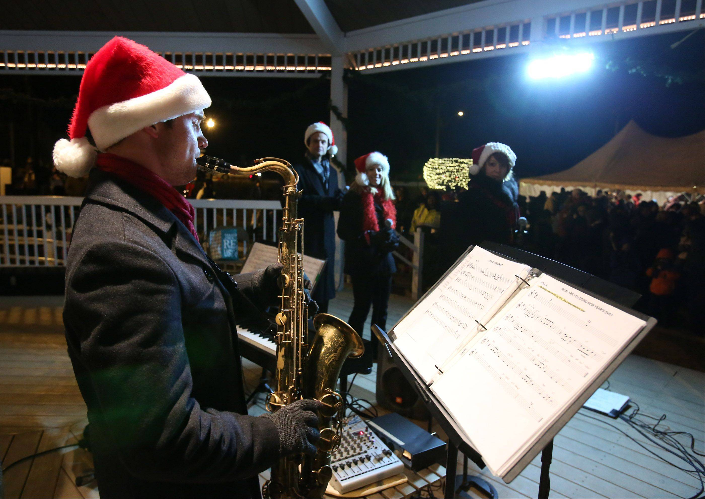 Ryan Eifert with Jazz Spectrum preforms at Mundelein�s holiday tree-lighting event Friday night at Kracklauer Park.