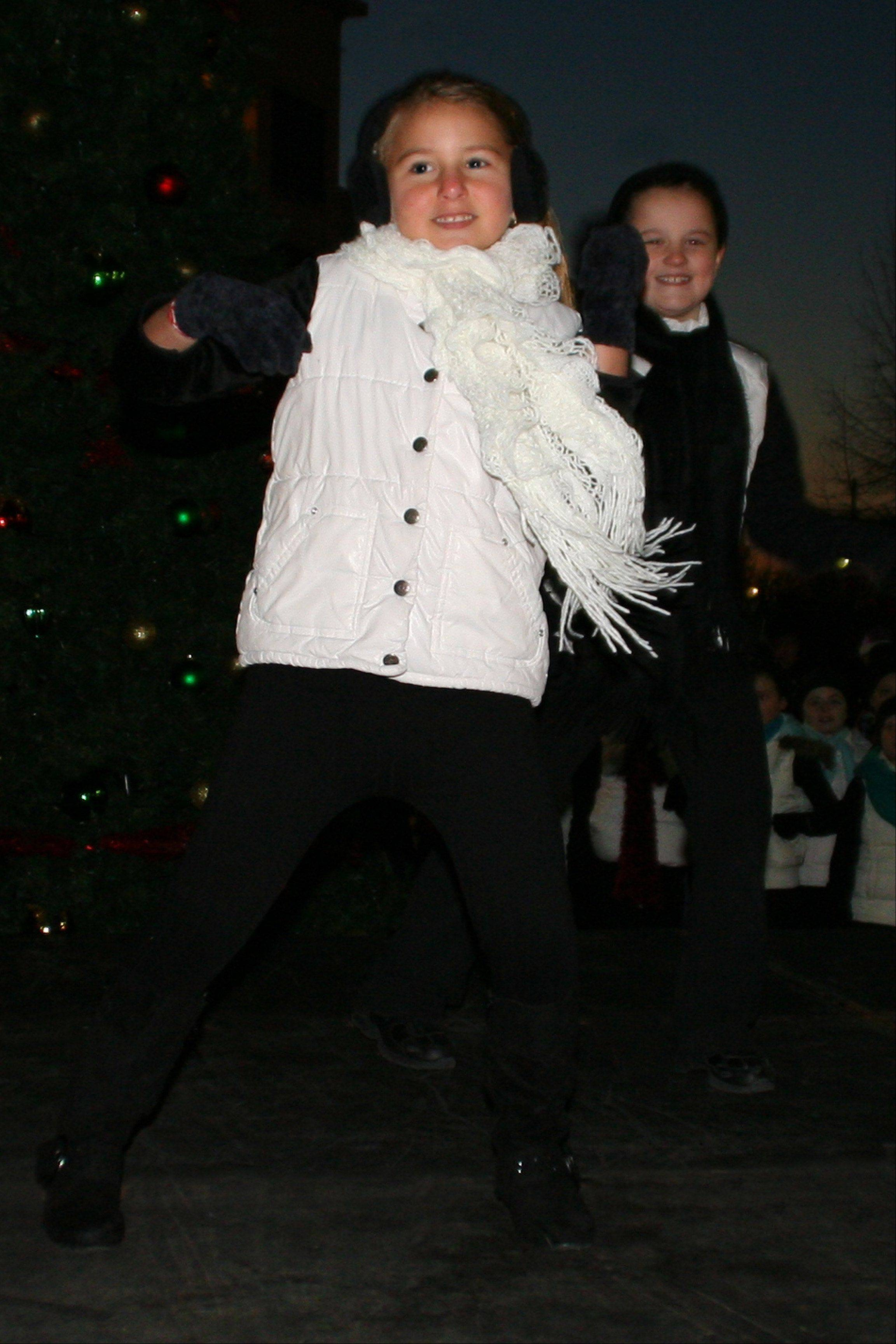LISA HARING/DES PLAINES PARK DISTRICT Artistry in Motion dancers Medina Dizdarevic and Josephine Groves perform �I Want a Hippopotamus for Christmas� on Friday at Des Plaines� tree-lighting event