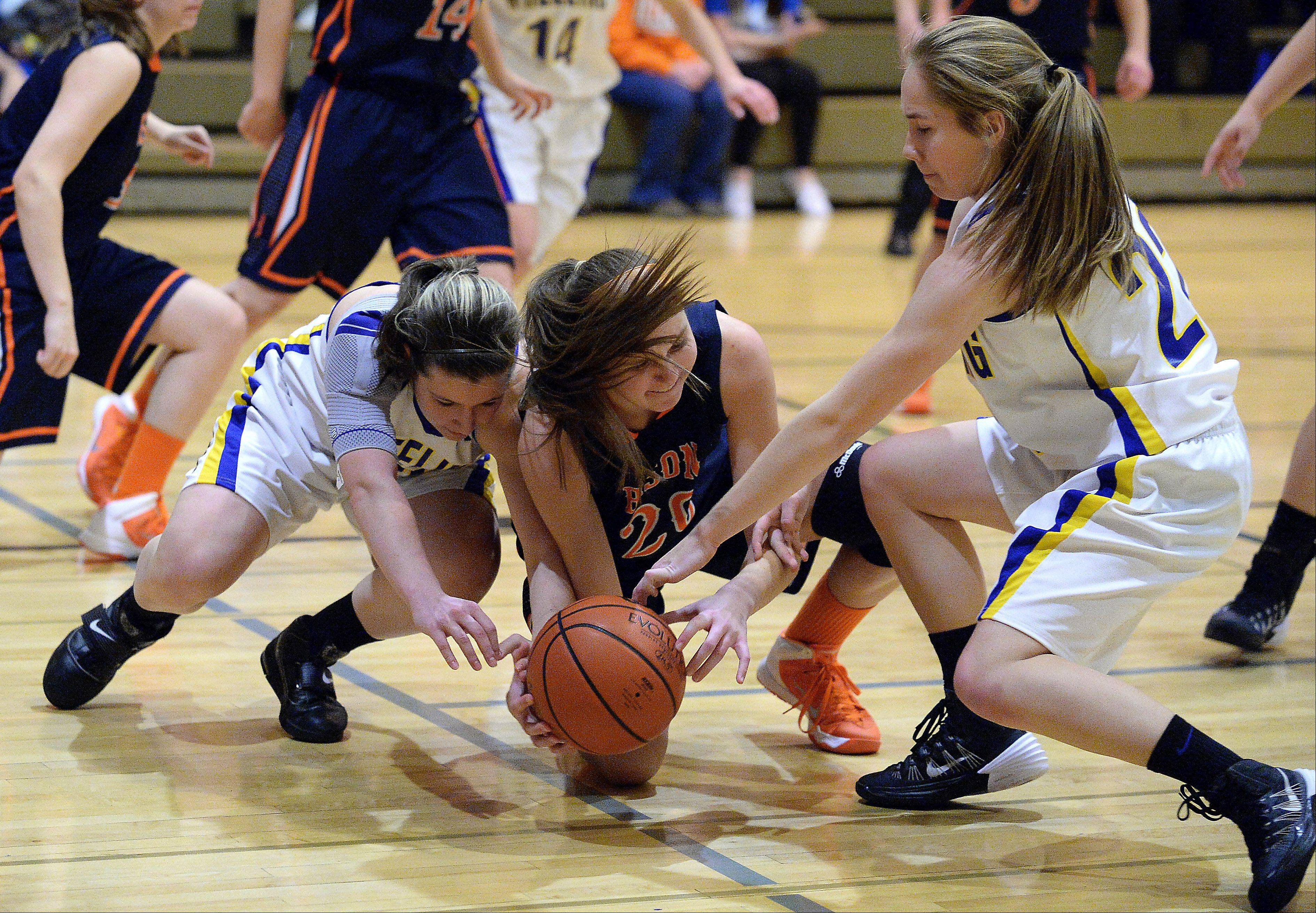 Buffalo Grove�s Courtney Meyer goes after a loose ball as Wheeling�s Nicole Zlotnikova, left, and Hailey Dammeier fight for control in the first half at Wheeling High School.