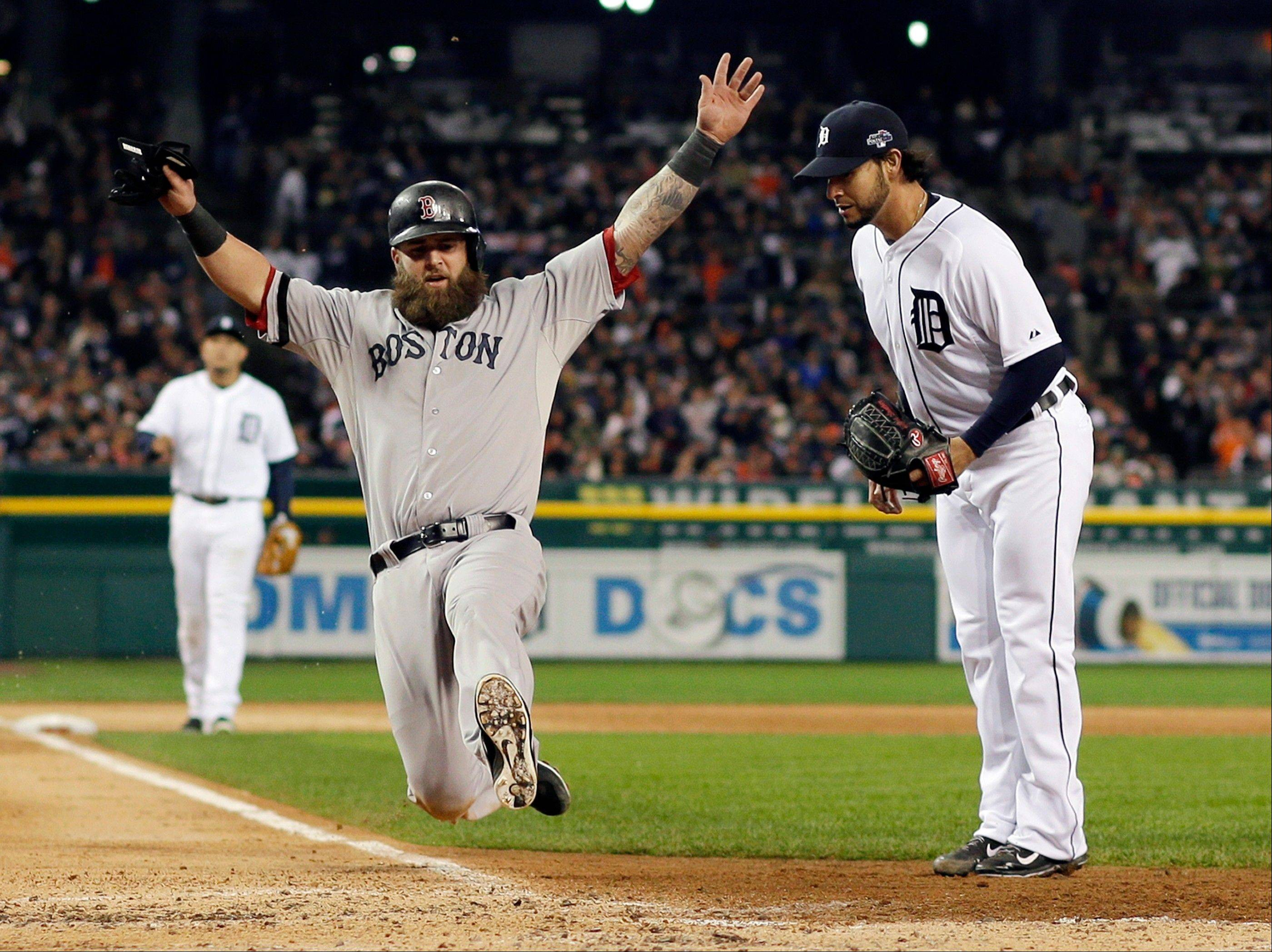 Boston�s Mike Napoli scores on a wild pitch by Detroit�s Anibal Sanchez during Game 5 of the American League Championship Series.