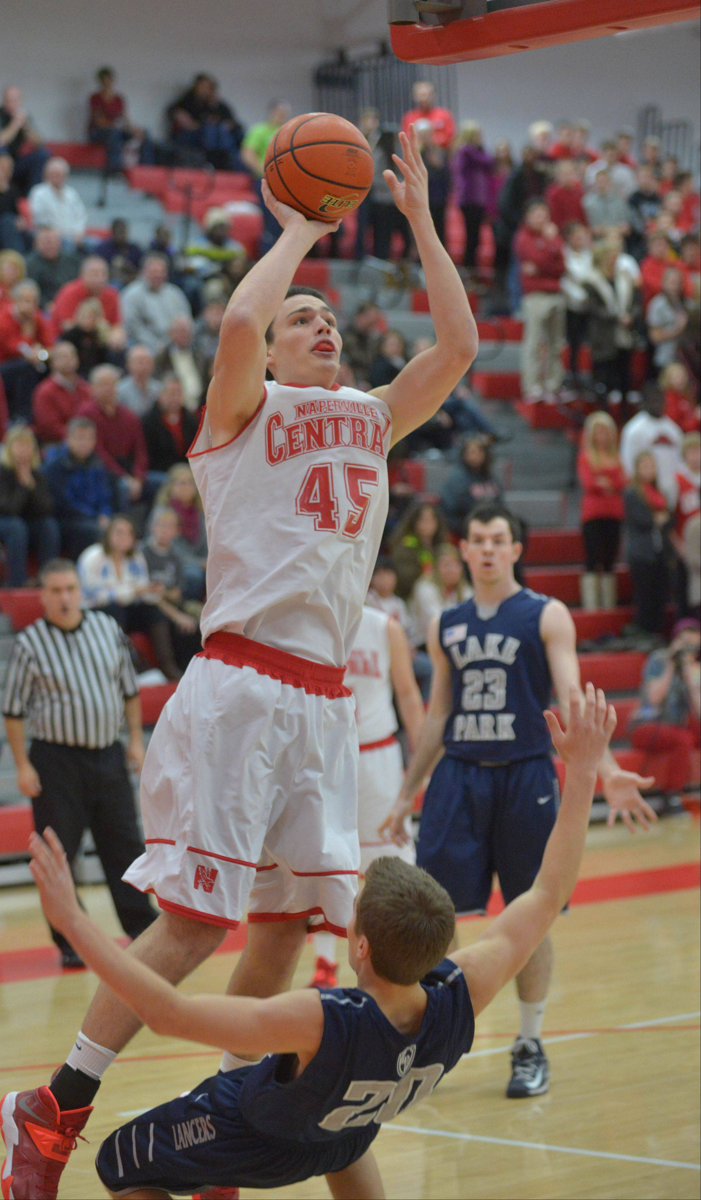 Nick Czarnowski of Naperville Central takes a shot during the Lake Park at Naperville Central boys basketball game Friday.