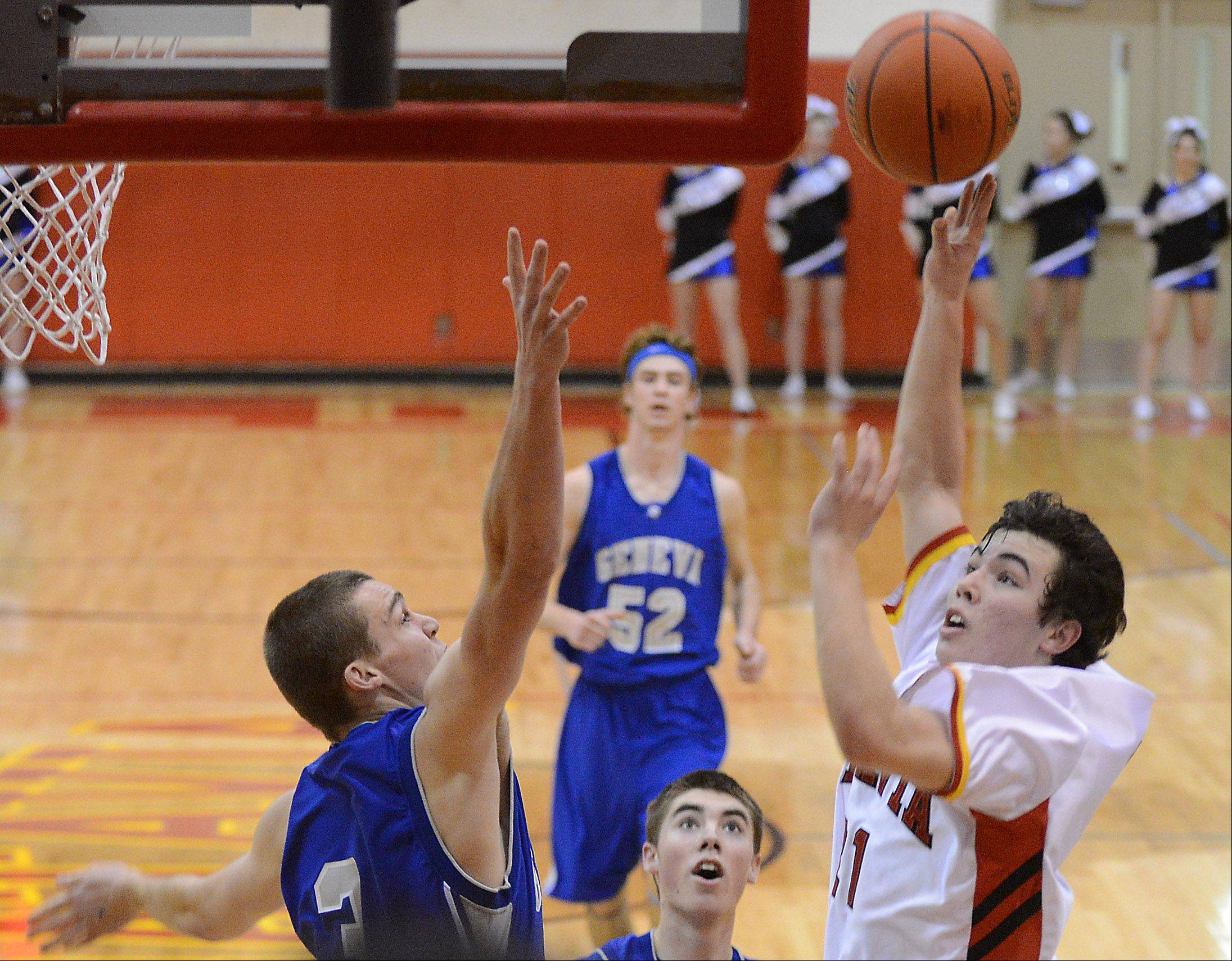 Batavia�s Jeremy Schoessling puts up a shot over Geneva�s Pace Temple.