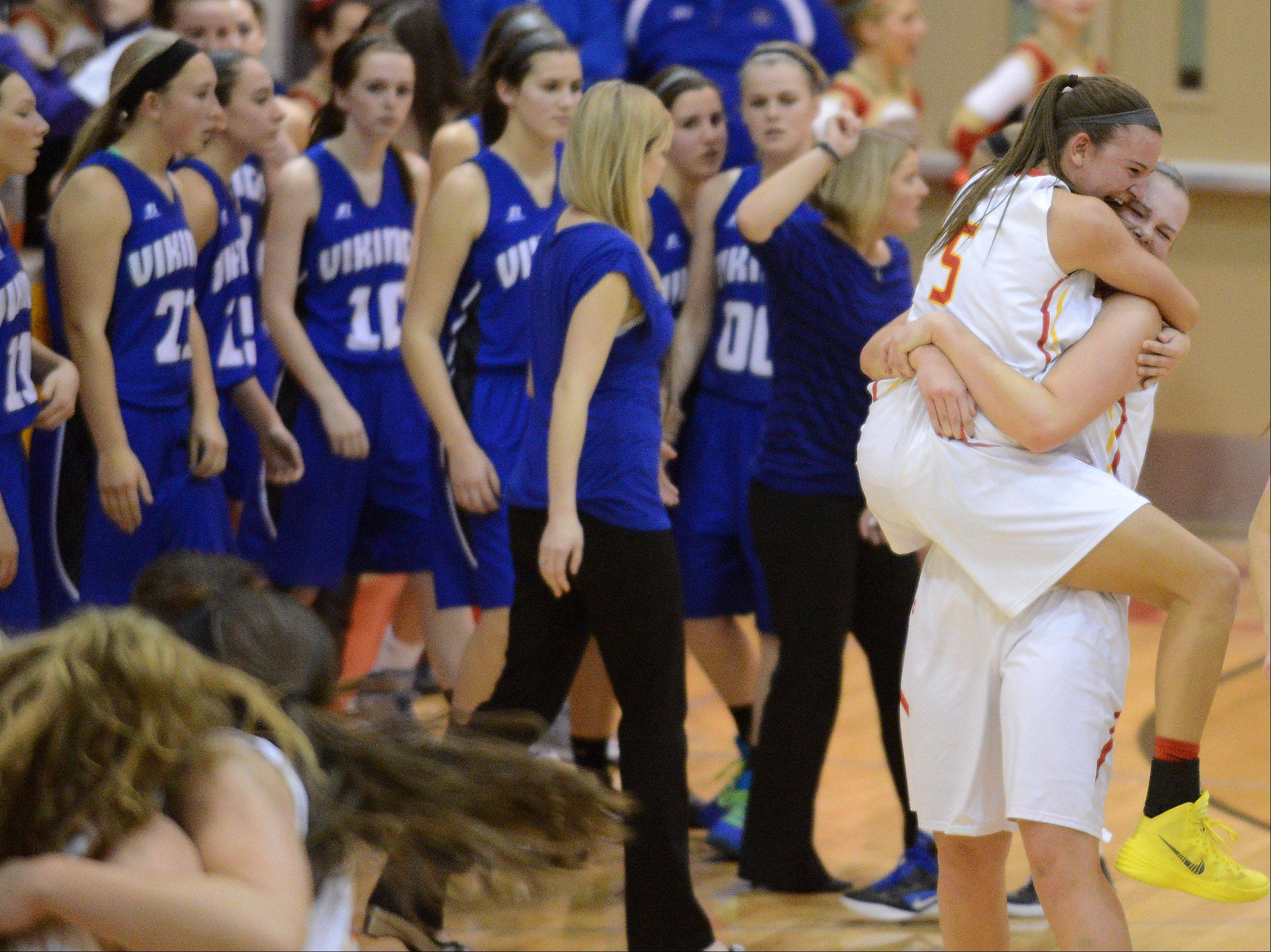 Batavia�s Liza Fruendt jumps in to the arms of teammate Erin Bayram after a victory over Geneva.
