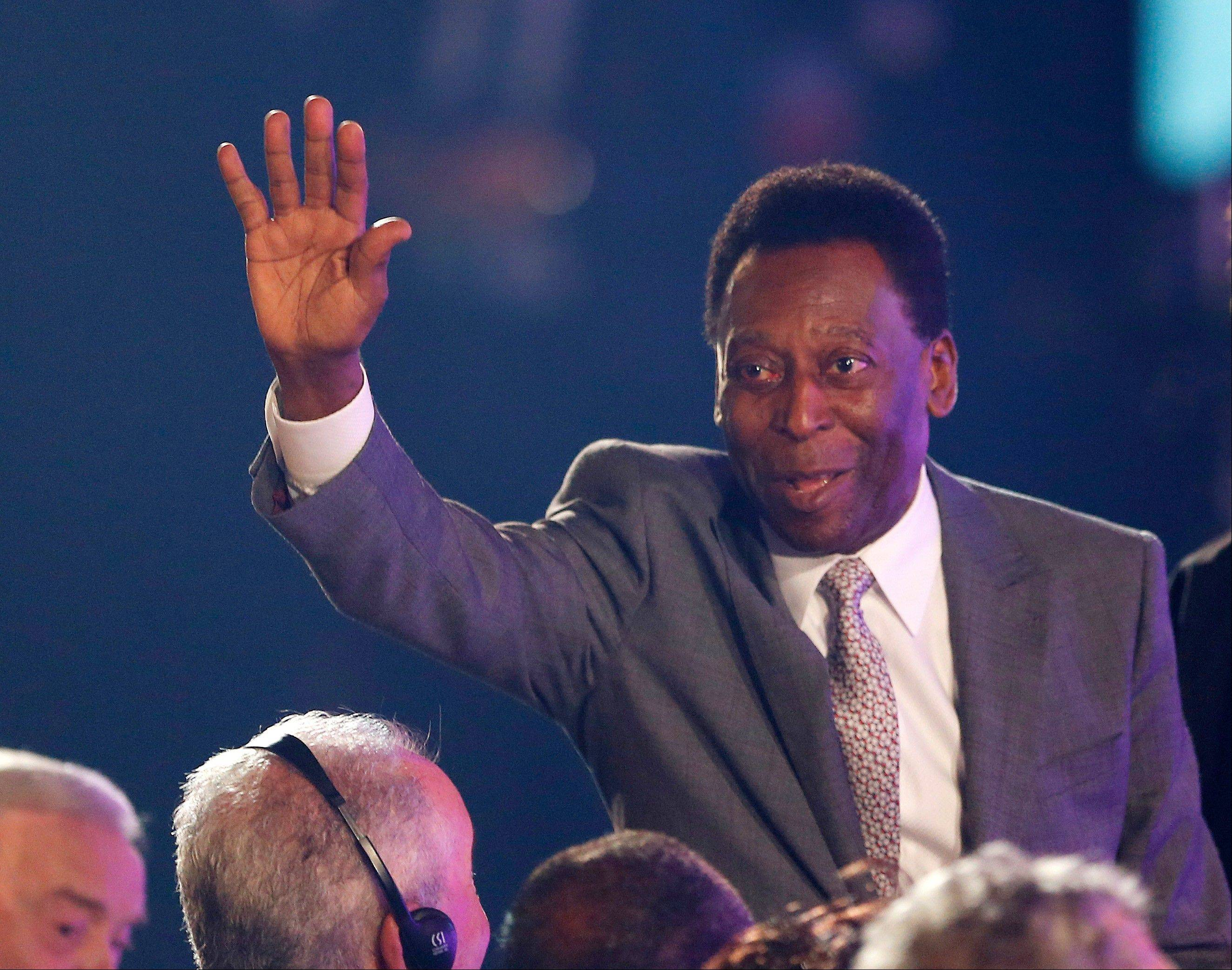 Brazilian soccer legend Pele, now 73 years old, took part in the draw ceremony for the 2014 World Cup.