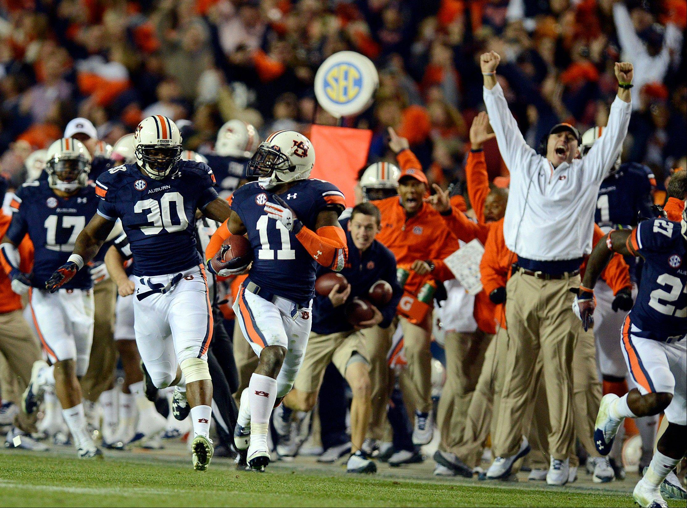 Auburn cornerback Chris Davis returns a missed field-goal attempt more than 100 yards for a touchdown on the final play of last Saturday�s game against Alabama.