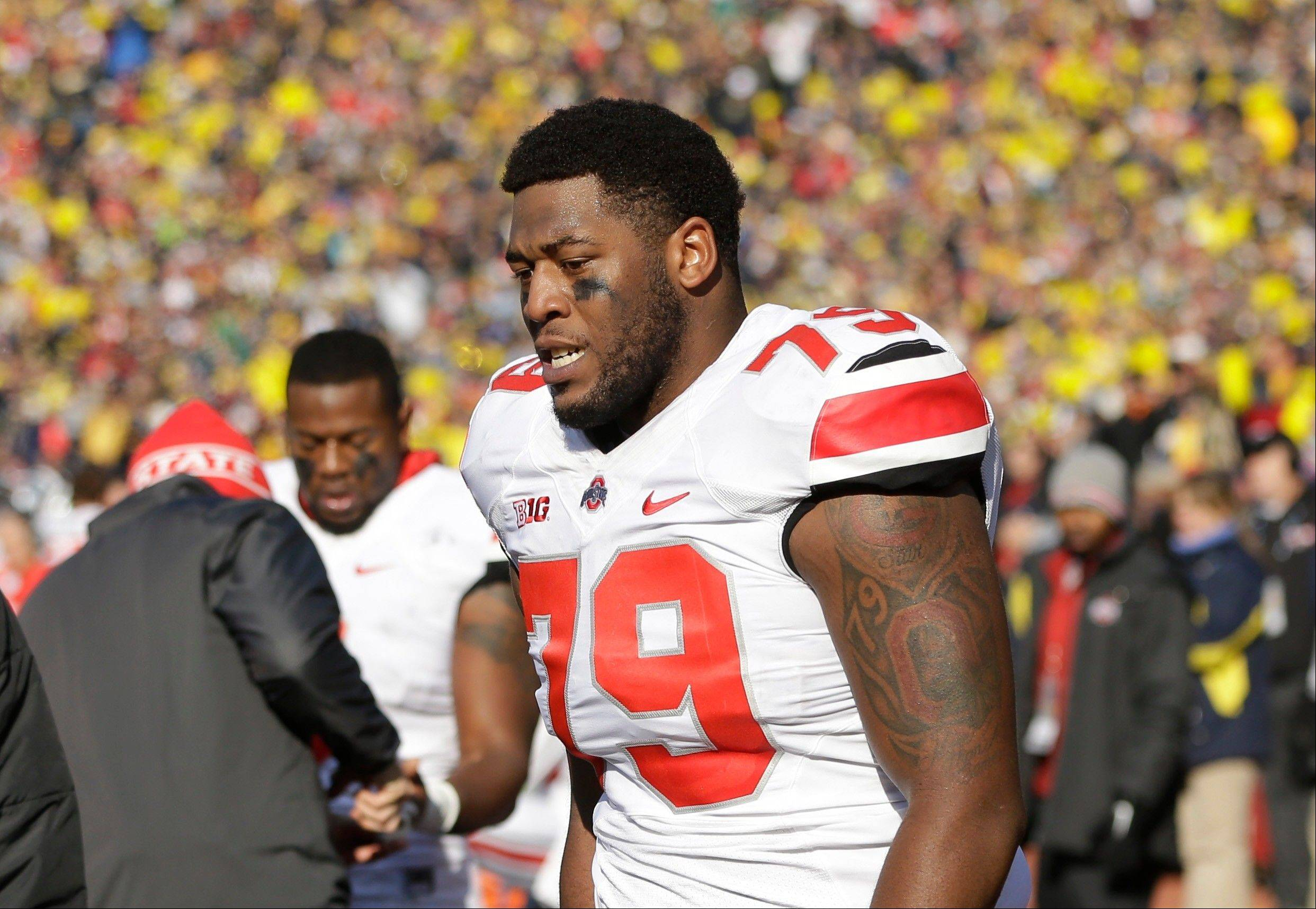 Ohio State offensive linesman Marcus Hall walks the sidelines after being ejected during the second quarter of last Saturday�s game at Michigan.