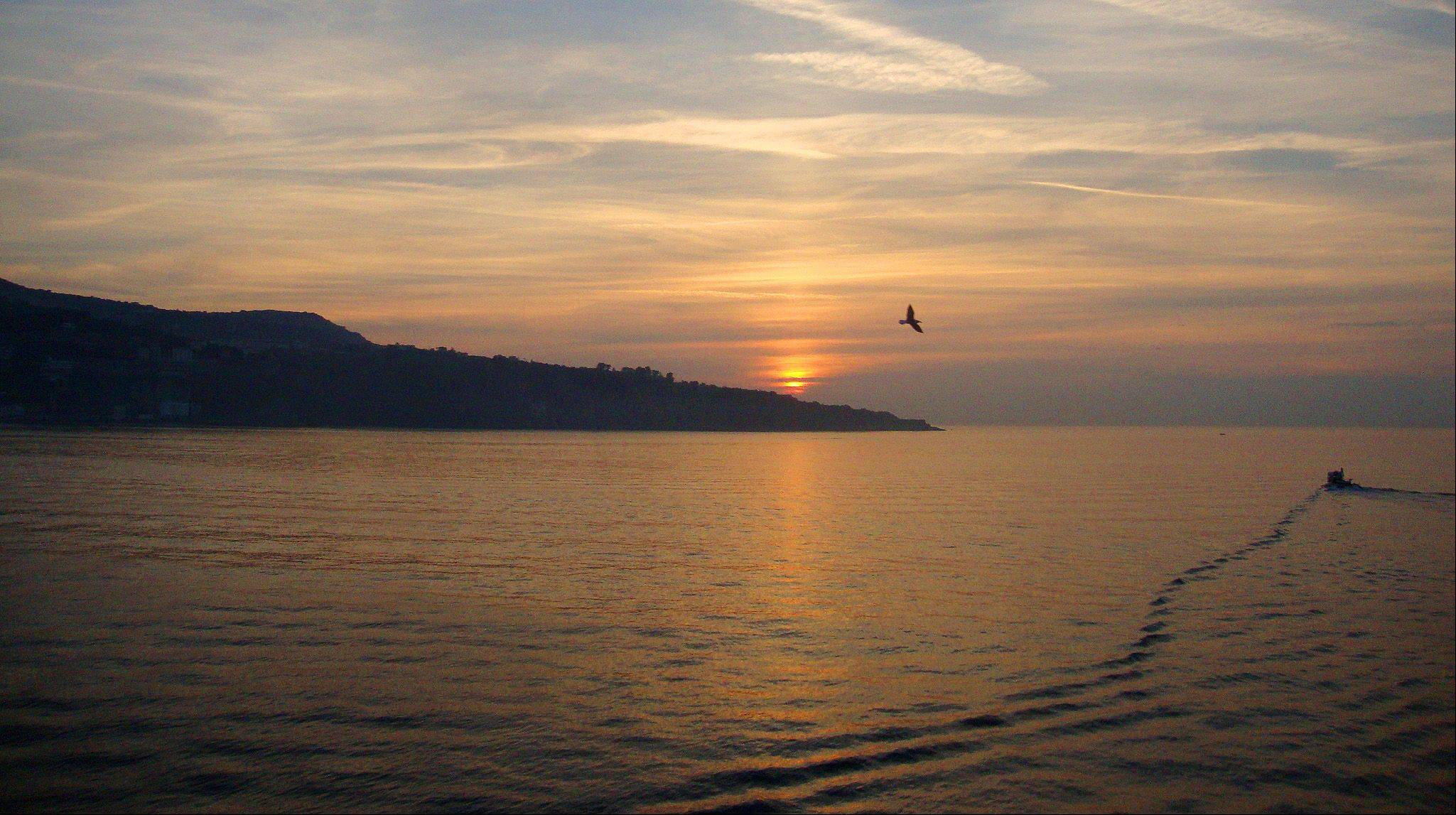 I took this photo off the coast of Sorrento, Italy in November. The sea was just still and flat. A perfect setting