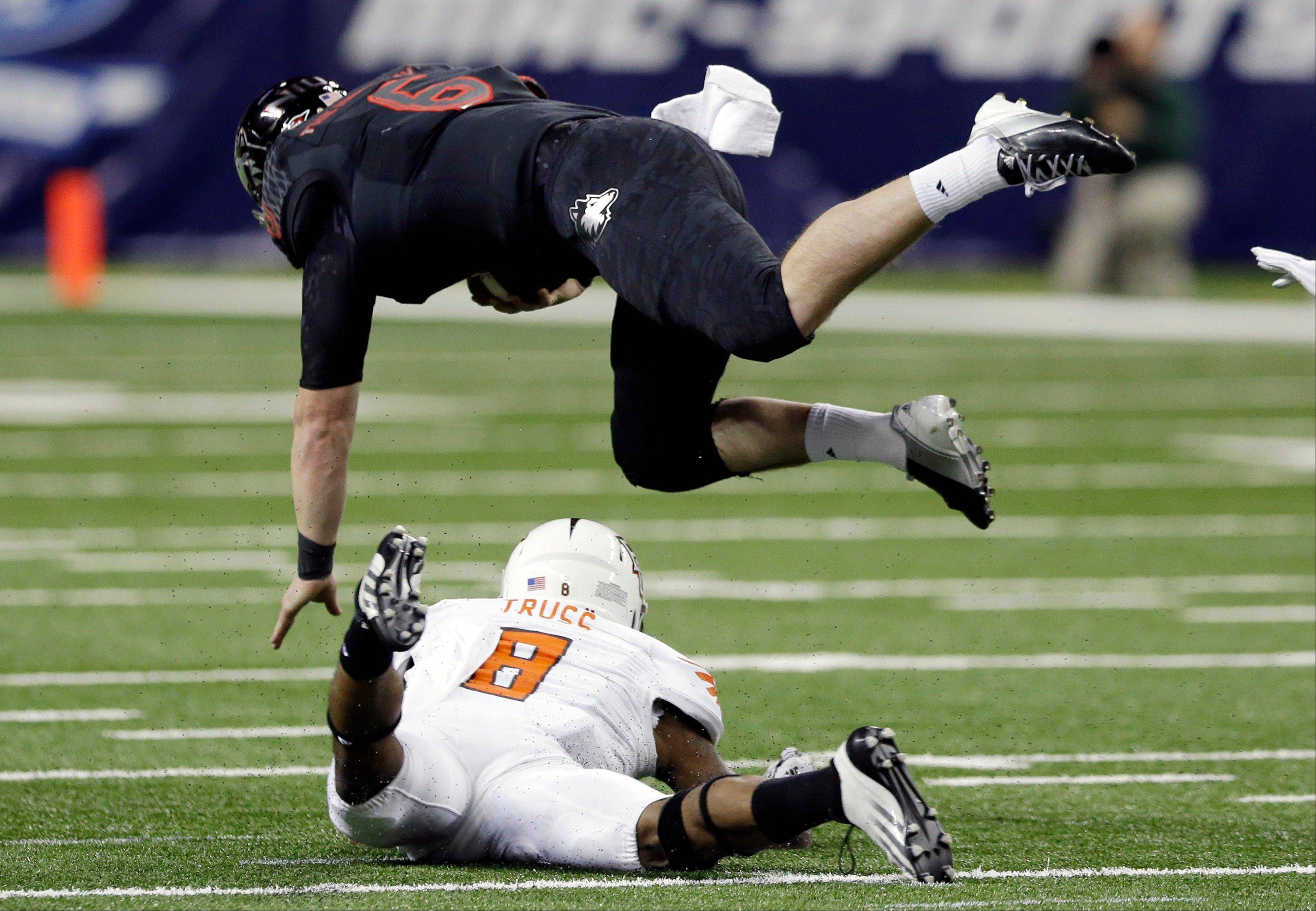 Bowling Green defensive back Cameron Truss upends Northern Illinois quarterback Jordan Lynch during the first half of the Mid-American Conference championship game Friday in Detroit.
