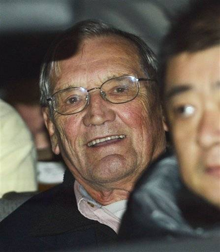 U.S. tourist Merrill Newman sits in a car after arriving at Beijing airport Saturday, Dec. 7, 2013 after being released by North Korea. North Korea deported Newman who was detained for more than a month, apparently ending the saga of his return to the North six decades after he advised South Korean guerrillas still loathed by Pyongyang.