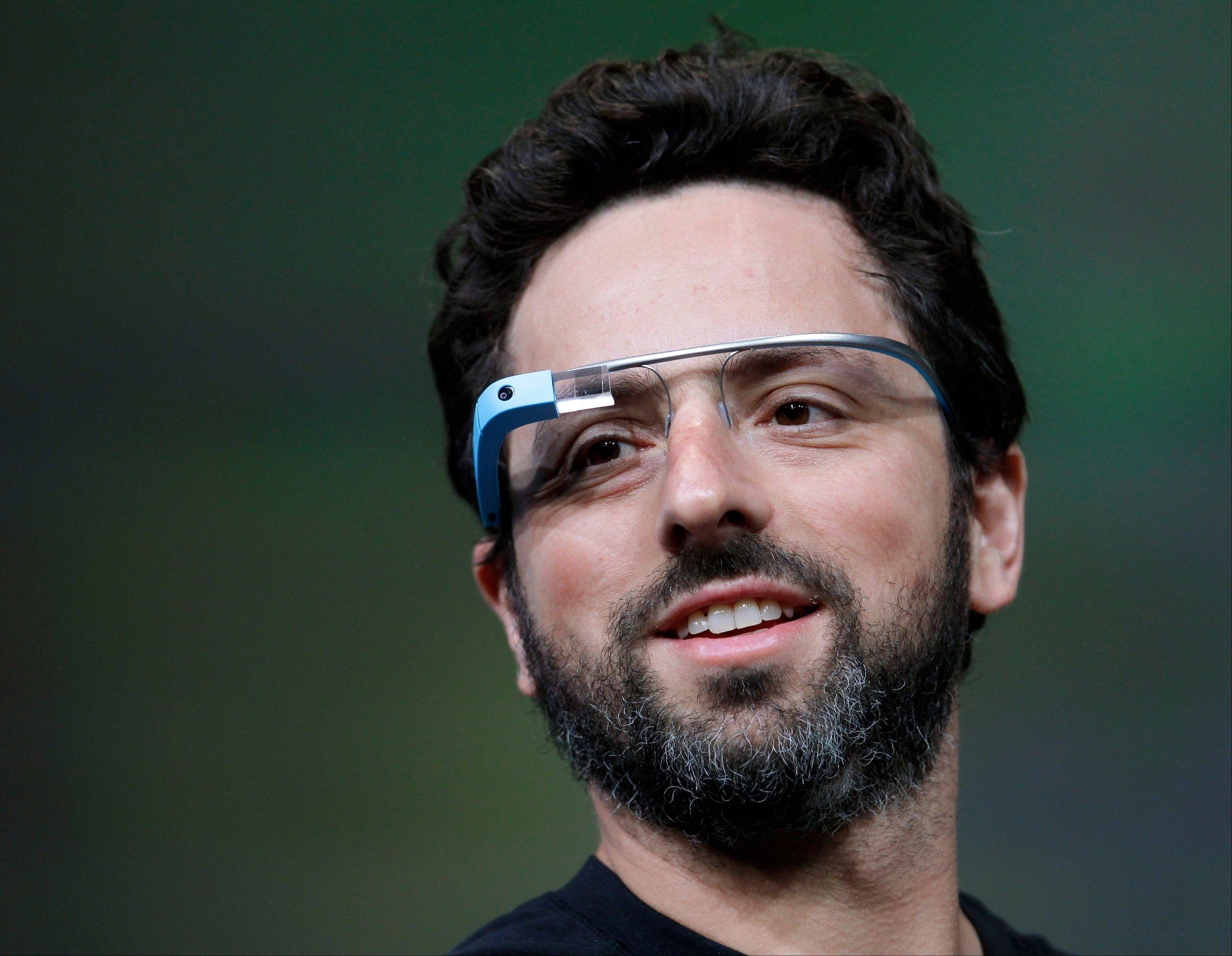 Google co-founder Sergey Brin demonstrates the company�s computerized glasses, which feature a thumbnail-size transparent video display on a lens in front of the user�s right eye.