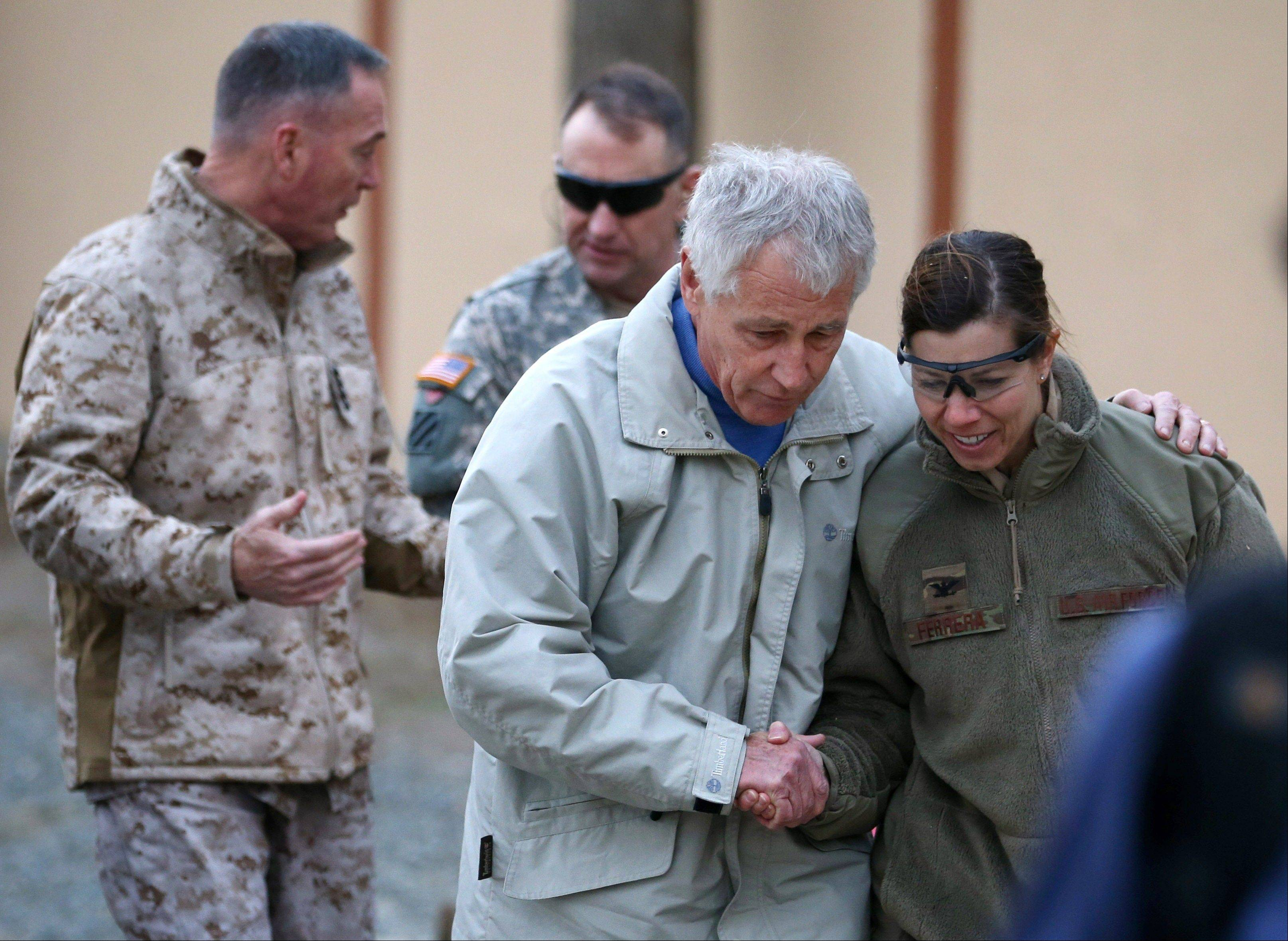 U.S. Secretary of Defense Chuck Hagel, center, is greeted Saturday by military personnel after arriving at International Security Assistance Force Headquarters (ISAF) in Kabul, Afghanistan.