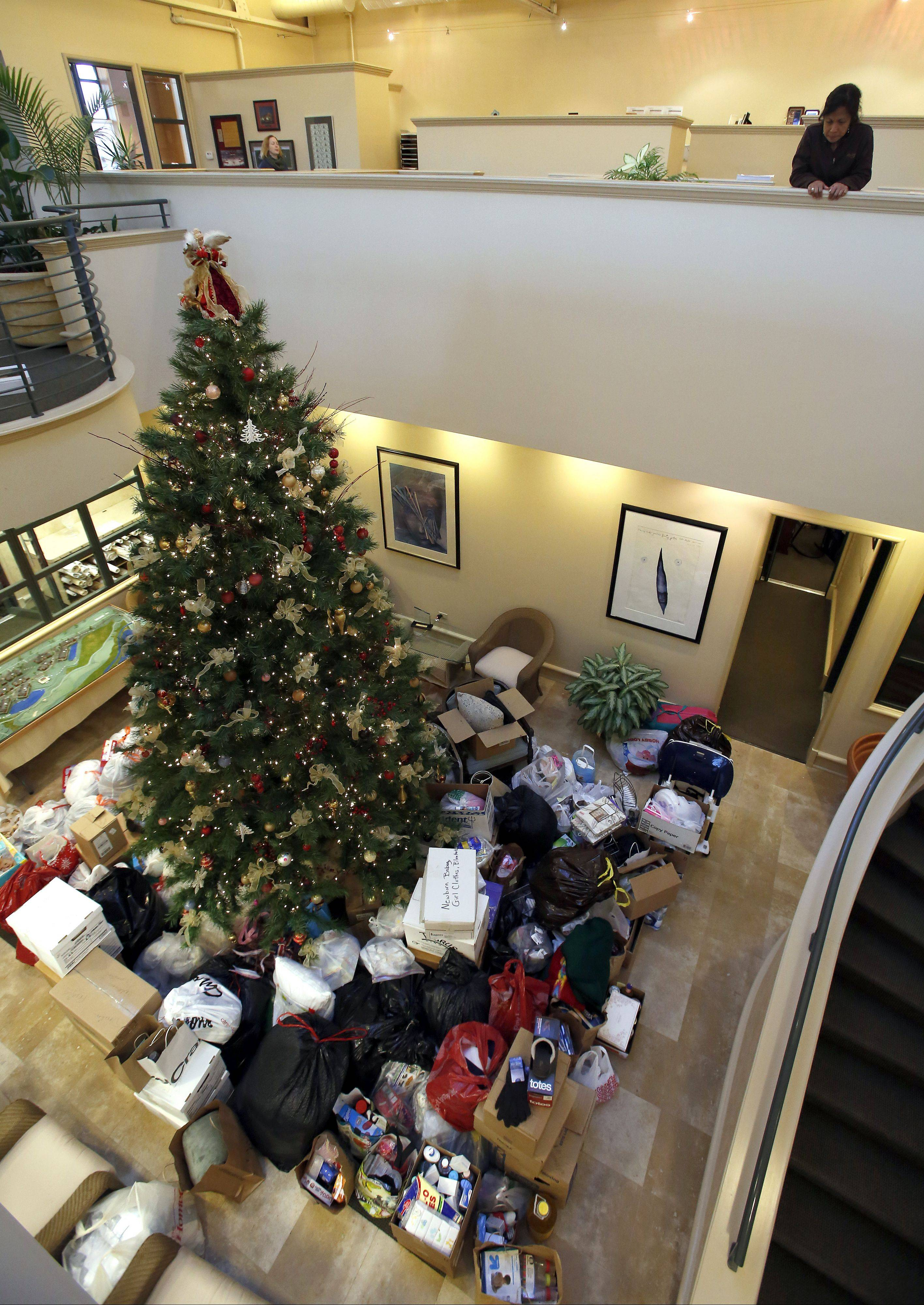 Items that have been collected for disaster relief for the Washington tornado victims sit at the bottom of a 20-foot Christmas tree Friday at Shodeen headquarters in Geneva. They will be delivered to the Washington area on Wednesday.