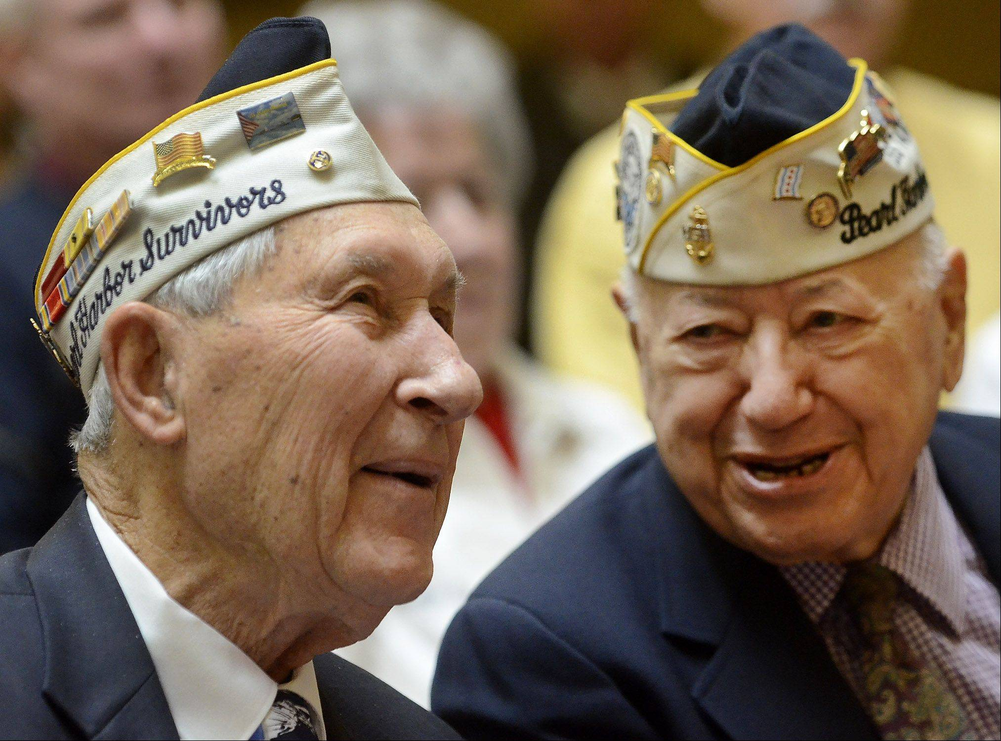 Lyle Hancock of Wheeling and Joe Triolo of Waukegan were among the survivors honored Friday in Des Plaines during a ceremony commemorating the 72nd anniversary of the attack on Pearl Harbor.