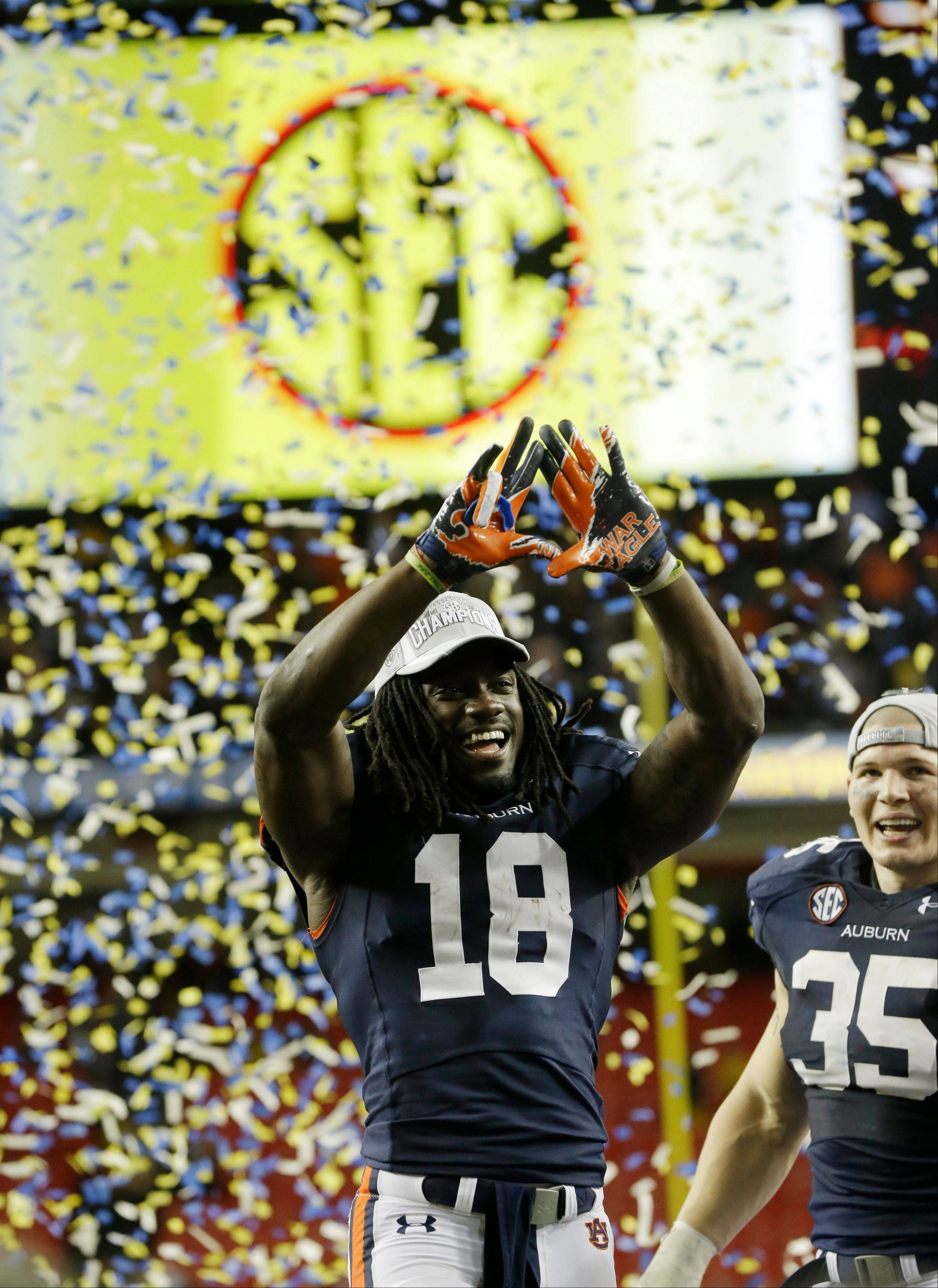 Auburn wide receiver Sammie Coates (18) celebrates after the second half of the Southeastern Conference NCAA football championship game against the Missouri Saturday in Atlanta. Auburn won 59-42.