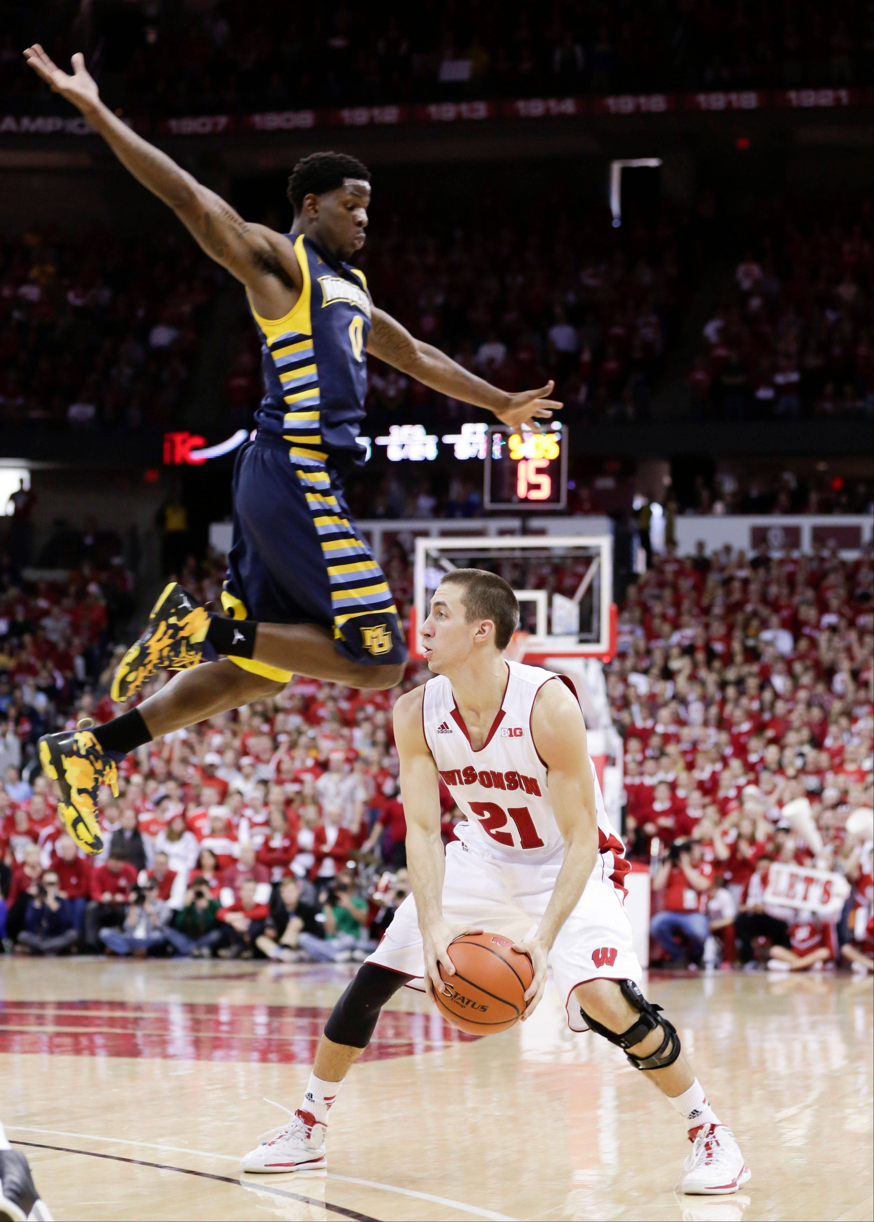 Wisconsin�s Josh Gasser looks to pass against Marquette�s Todd Mayo during the second half of Saturday�s game in Madison.