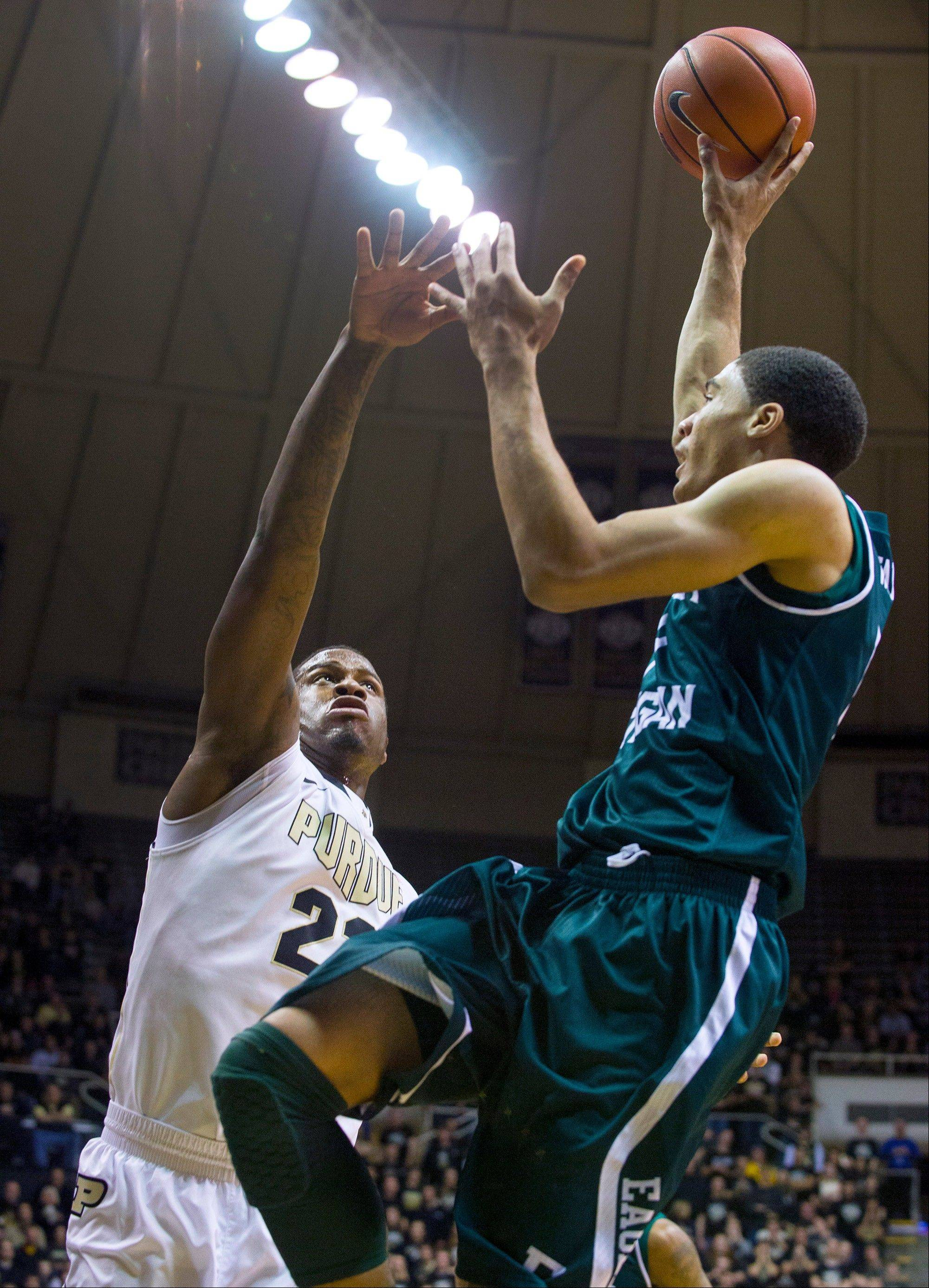 Associated Press Eastern Michigan�s Karringtonn Ward gets a shot off over Purdue�s Jay Simpson in the first half of Saturday�s game in West Lafayette, Ind.