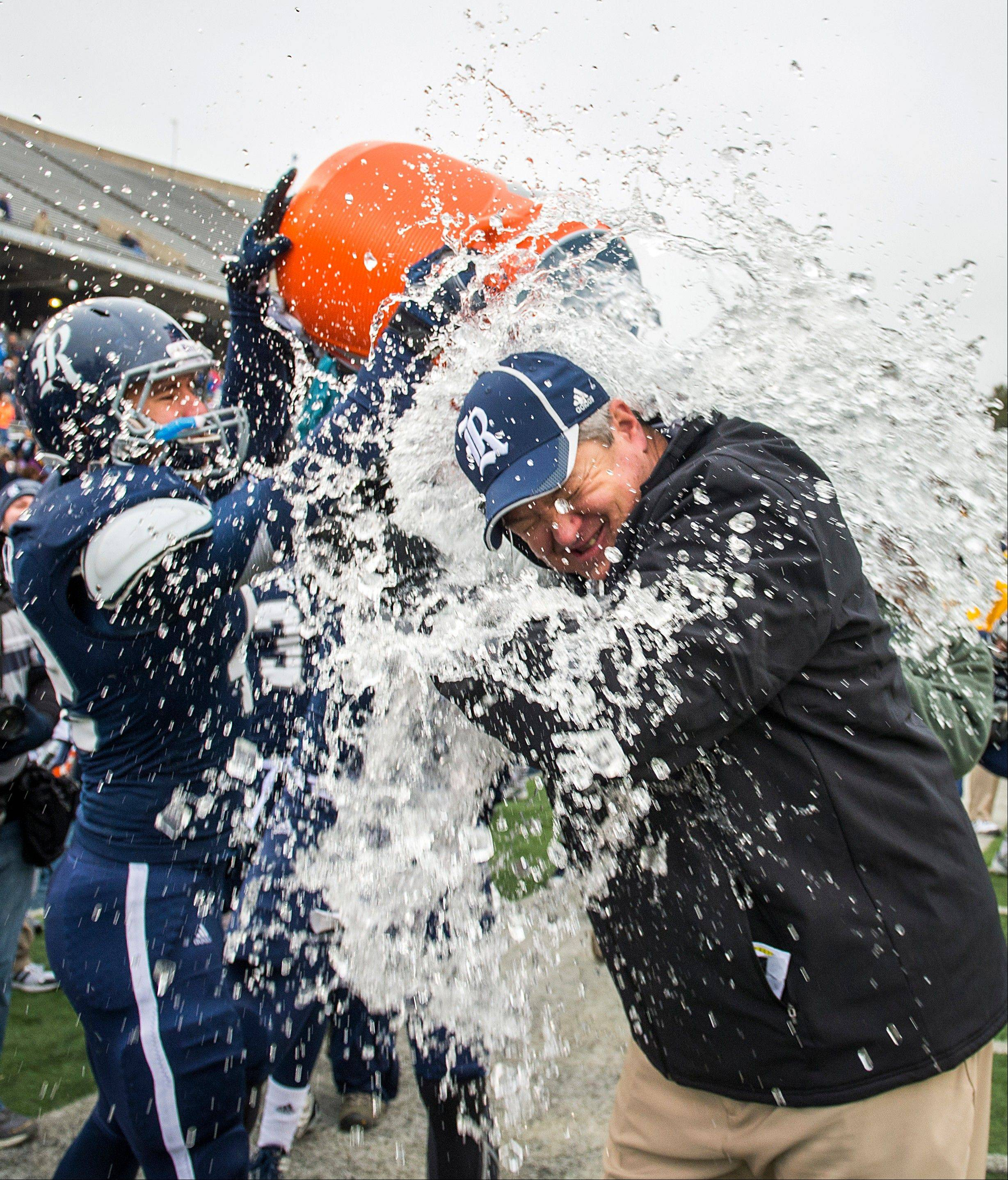 Rice players douse head coach David Baliff after the Owls defeated Marshall 41-24 in the Conference USA championship game Saturday at Rice Stadium in Houston.