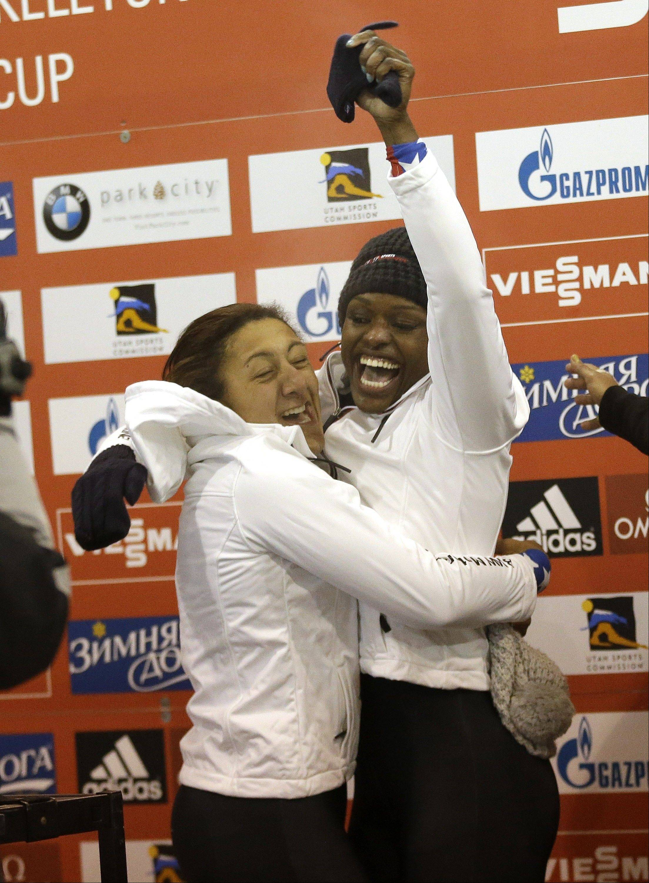 The United States� Elana Meyers, front, and Aja Evans celebrate after a women�s World Cup bobsled race Friday in Park City, Utah.