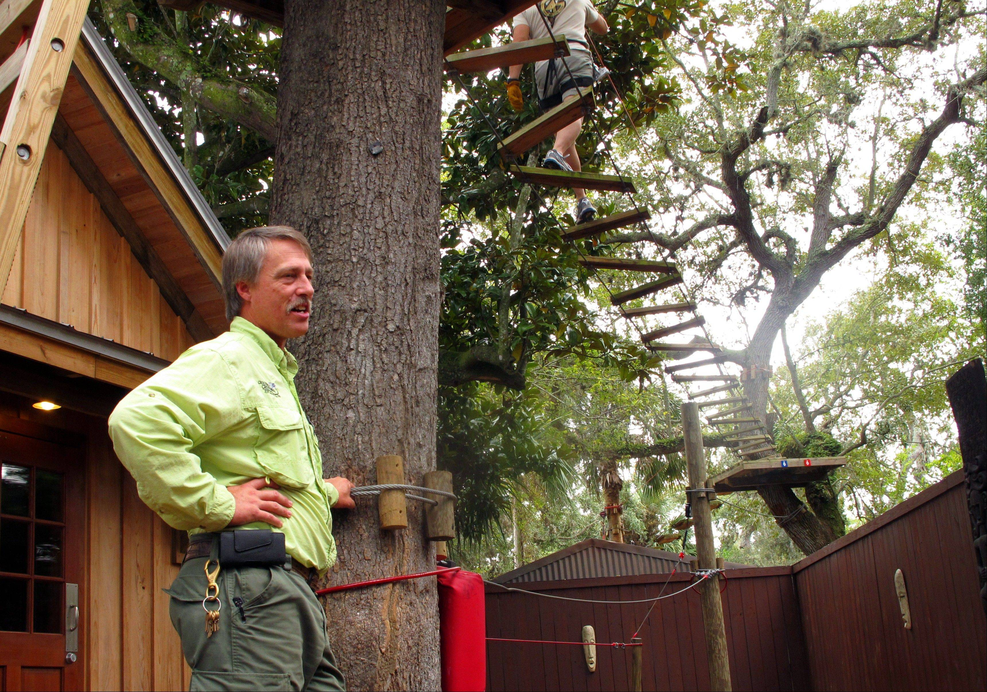 Manager Scott Brown stands at the first of 49 stations on the obstacle course at the St. Augustine Alligator Farm in St. Augustine, Fla.