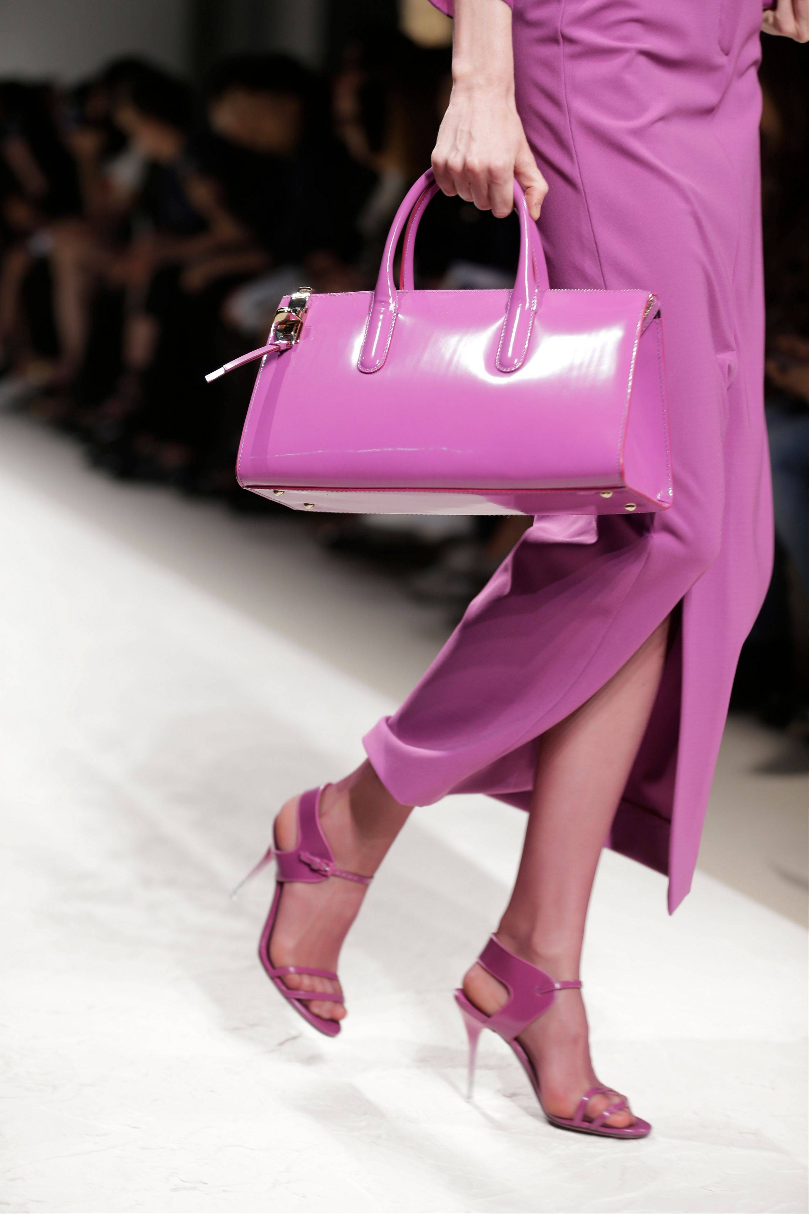 A model wears a creation for Max Mara women's Spring-Summer 2014 collection, part of the Milan Fashion Week, unveiled in Milan, Italy. Orchid is growing on us: A version of the purple hue is Pantone Inc.'s color of the year for 2014.