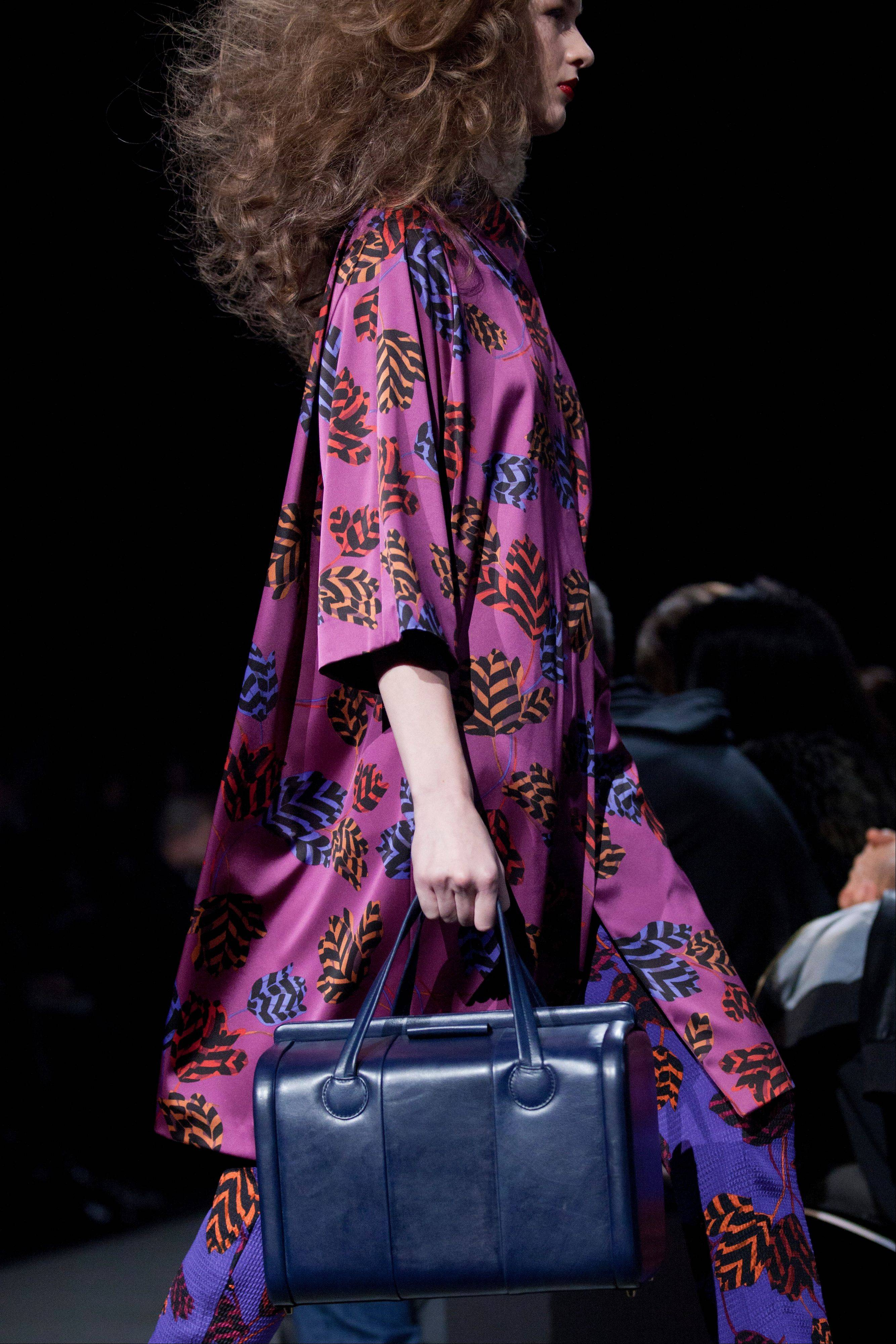 A model walks the runway during the Marc by Marc Jacobs Fall 2013 fashion show during Fashion Week in New York. Orchid is growing on us: A version of the purple hue is Pantone Inc.'s color of the year for 2014.