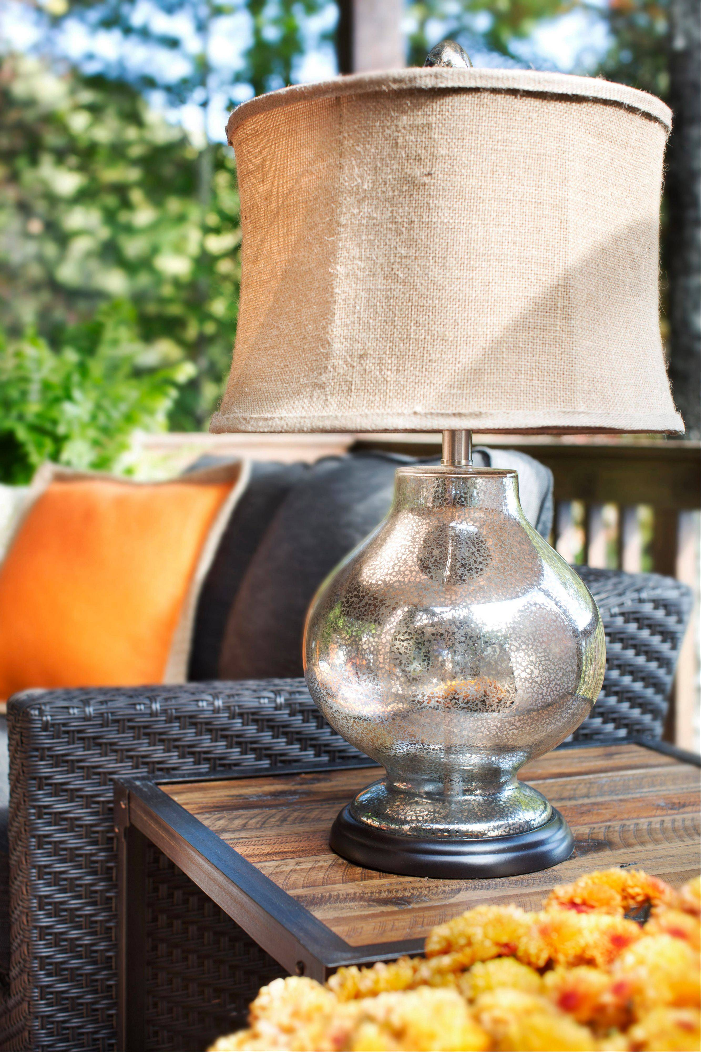 Flynn puts his outdoor table lamps on timers to ensure they're turned off nightly and preserve energy. Flynn also suggests taking textural values into consideration, noting that warm textures like burlap and wood help warm a place up visually.