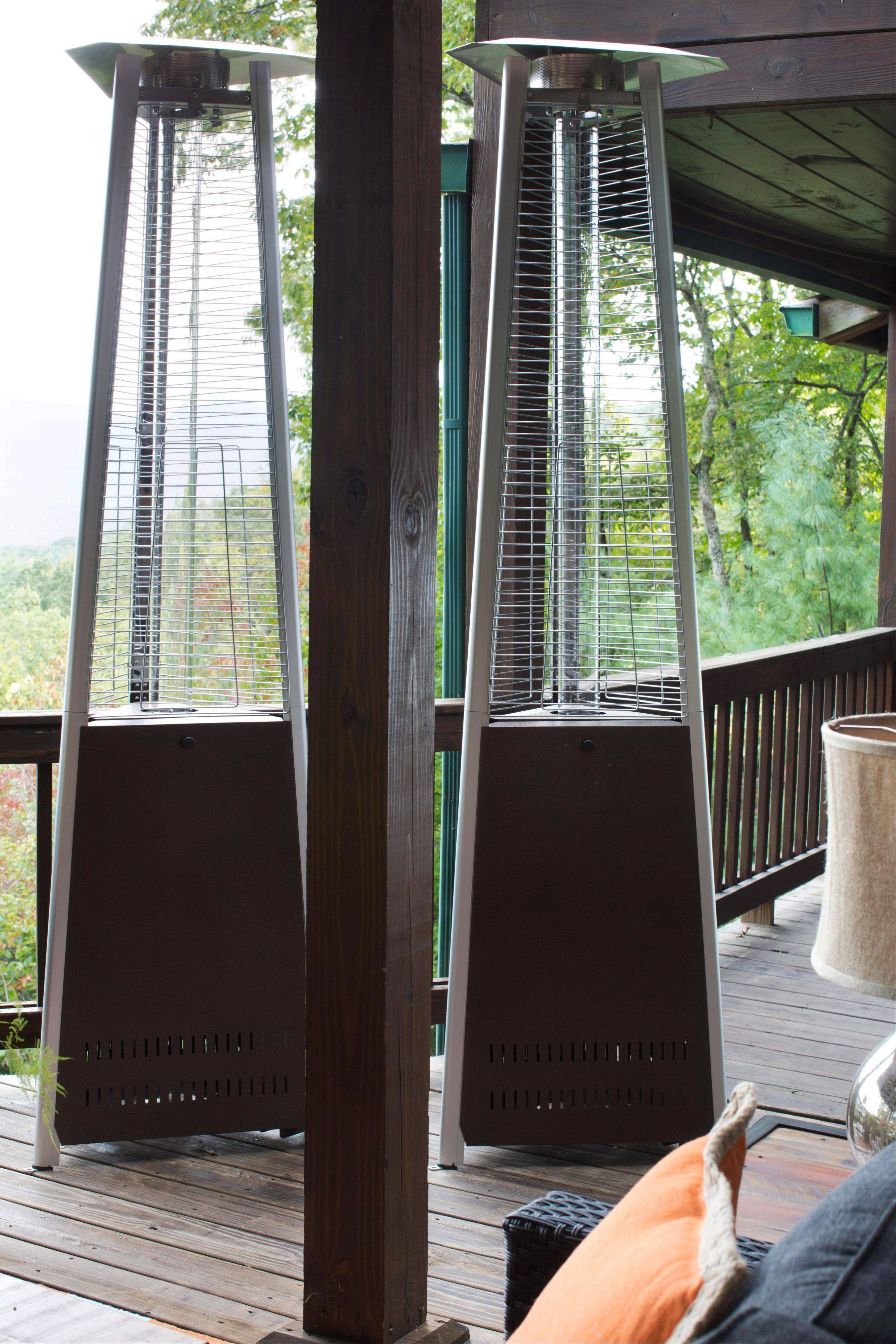 Flynn keeps sculptural outdoor heaters standing by his covered outdoor living room. Should the weather become cold, these easily wheel back and, bringing the proper amount of heat wherever it's needed.