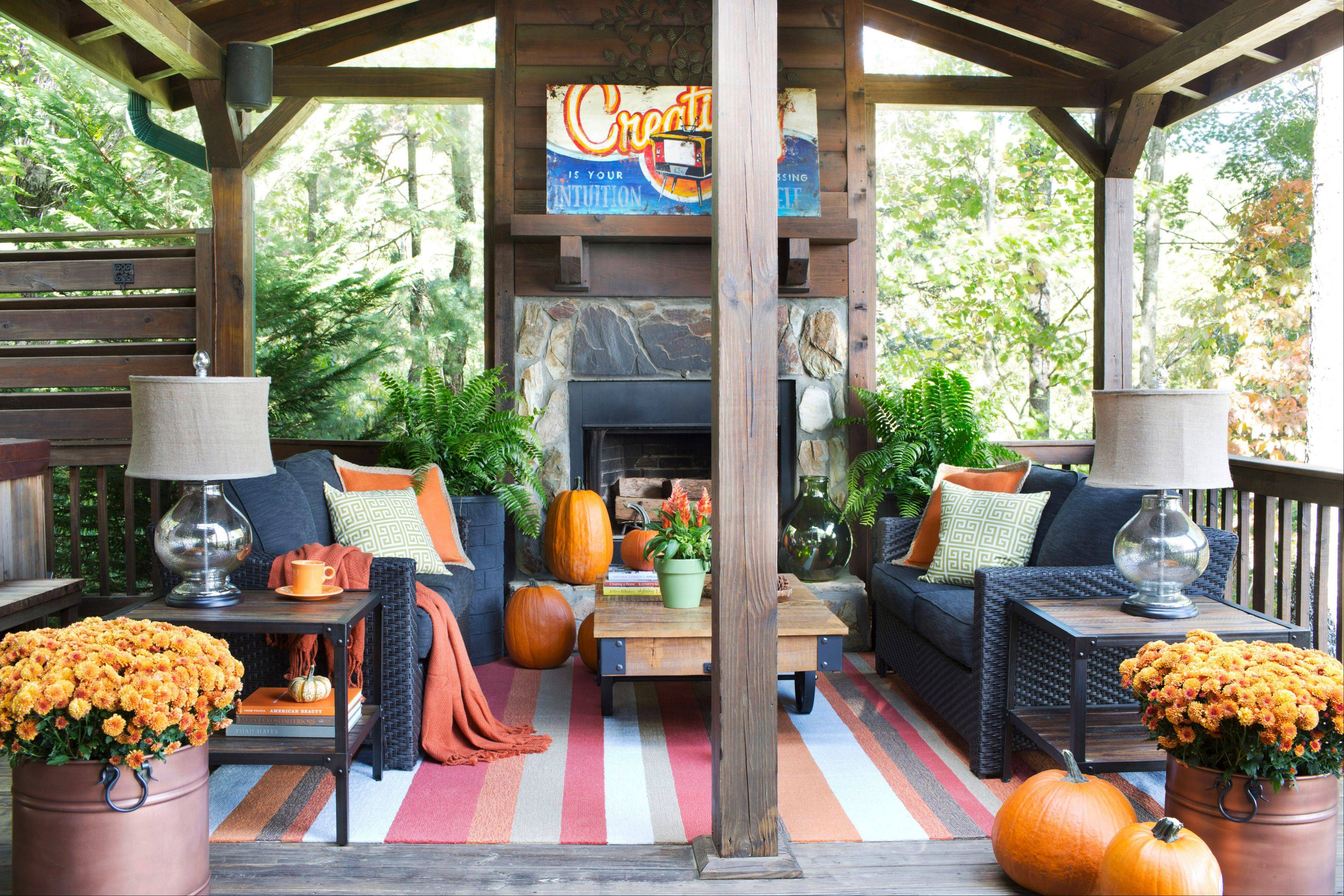 To ensure the outdoor living space of his mountain house stays warm and welcoming during the colder months, designer Brian Patrick Flynn chose woven blend upholstery for his seating, and a wool and acrylic blend indoor-outdoor area rug.