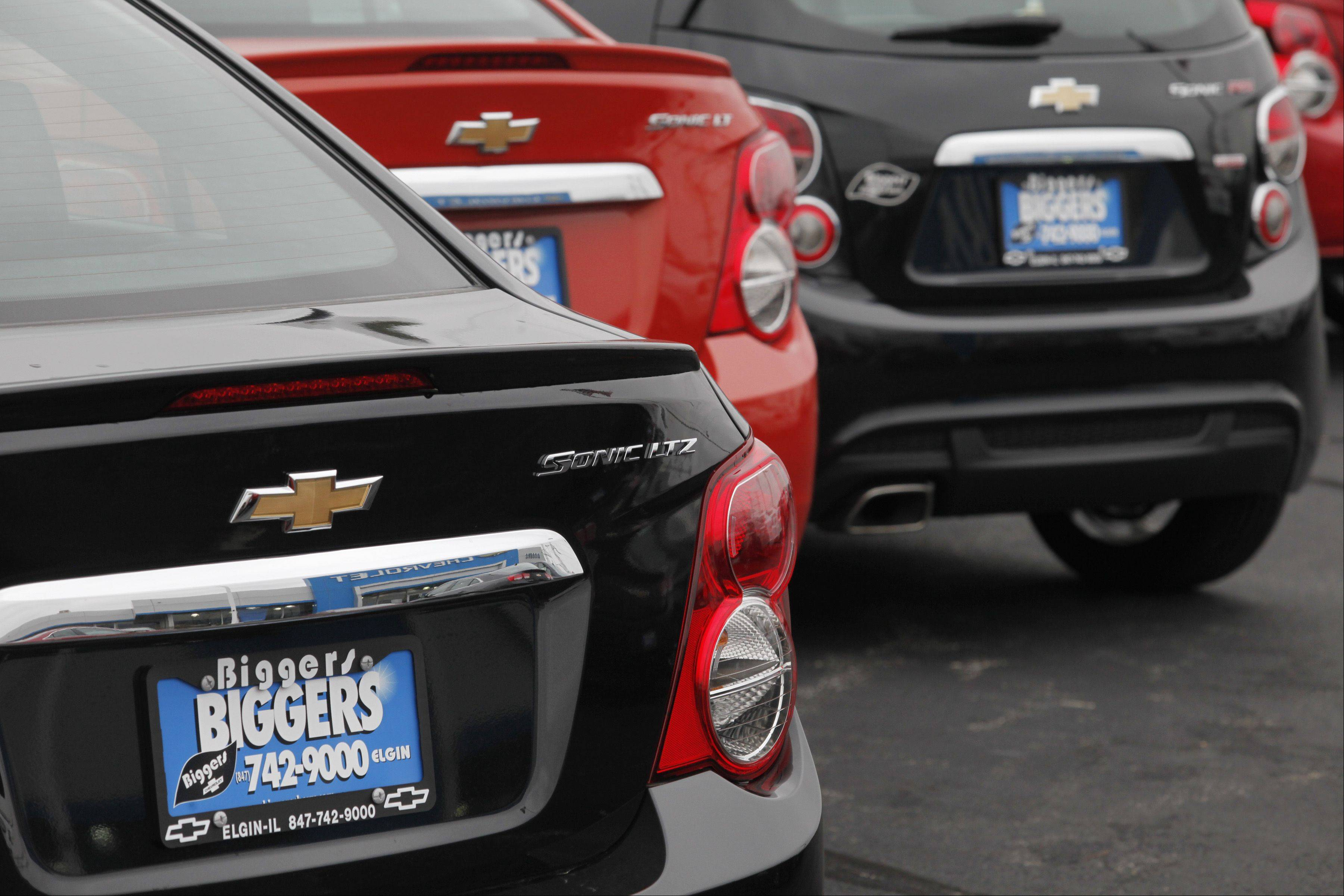 A row of Chevy Sonic models at Biggers Chevrolet in Elgin.