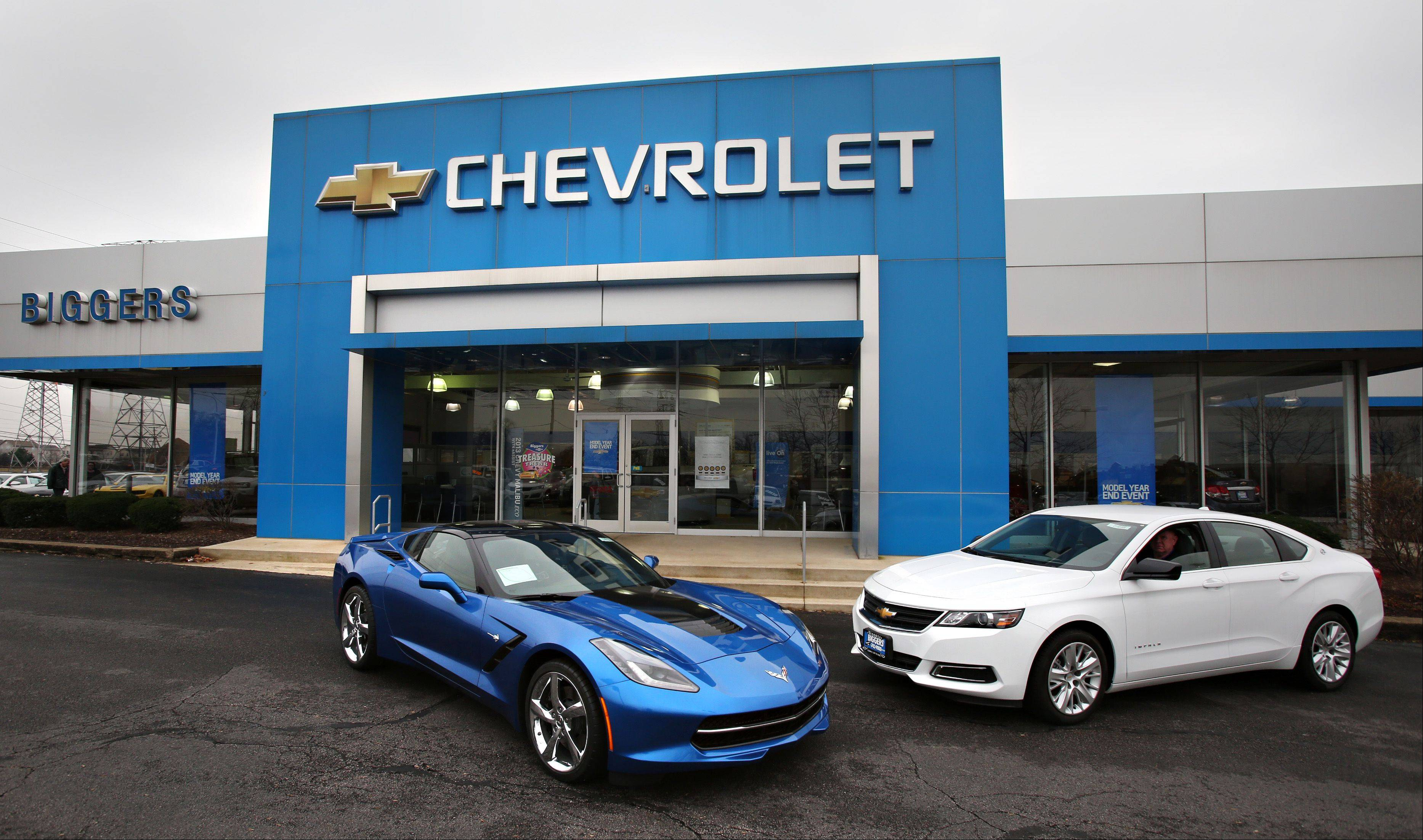 The Chevrolet Corvette Stingray, left, and Impala at Biggers Chevrolet in Elgin. Both models were given significant redesigns for 2014 that have earned rave reviews.