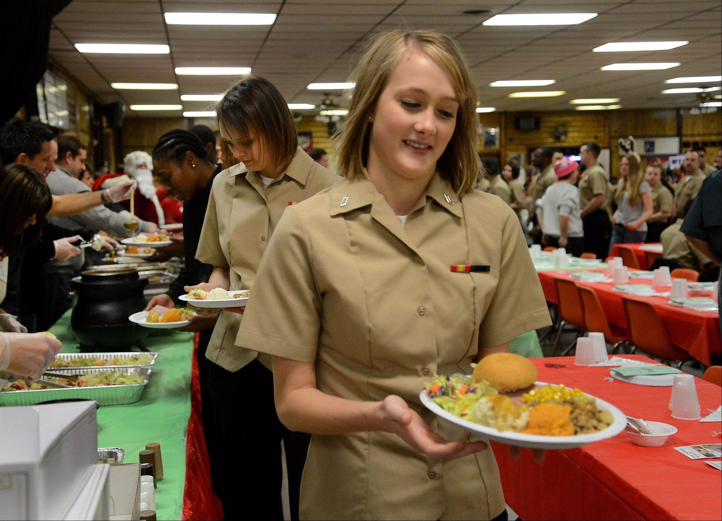 Electrician's Mate Nicole Hibler fills her plate as the VFW in Antioch hosted 350 sailors from Great Lakes and 50 veterans from Lovell and Hines hospitals Saturday for a full Christmas dinner.