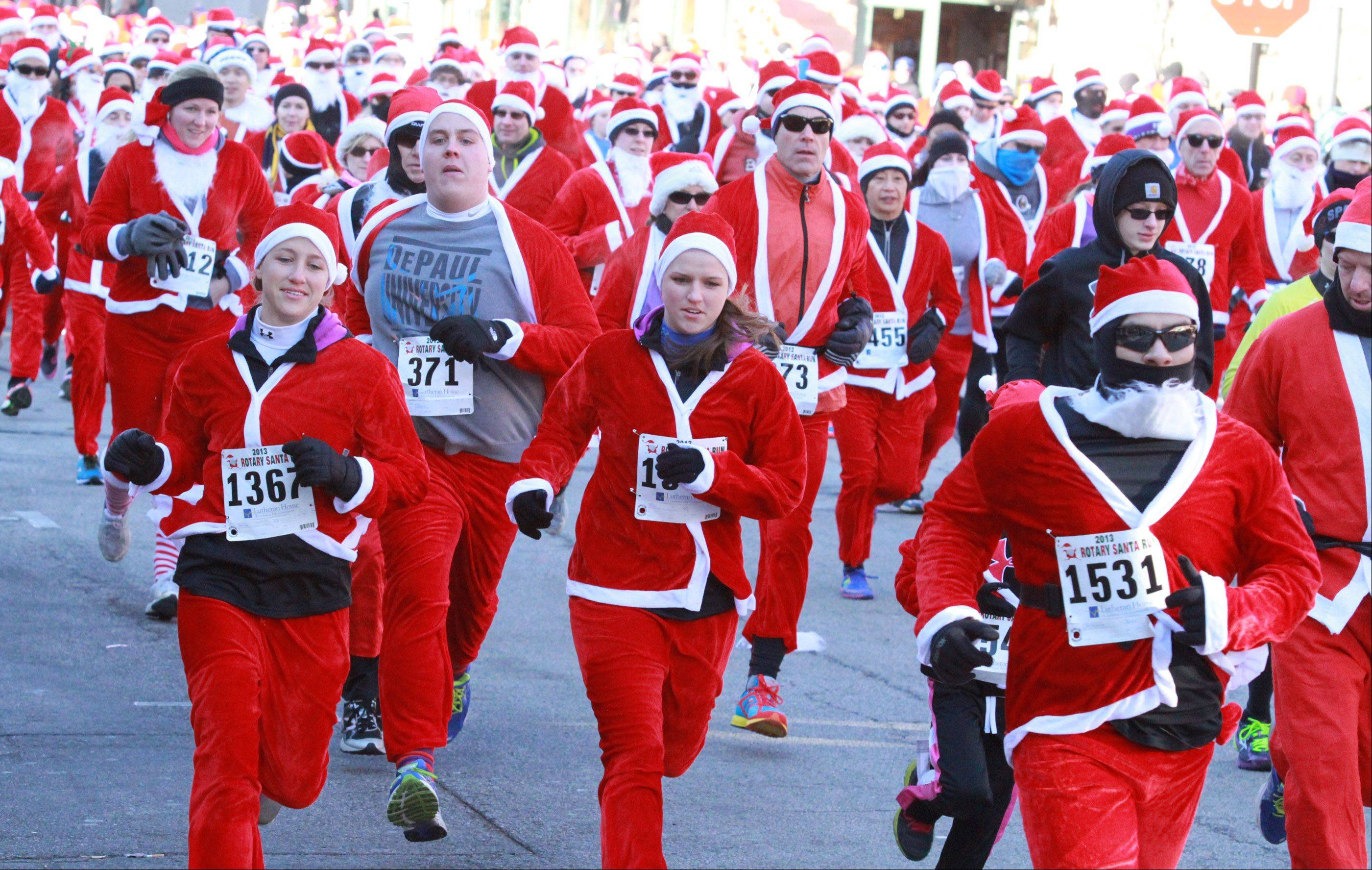More than 1,600 runners in Santa Claus costumes participated in the Rotary Santa Run on Saturday in Arlington Heights.