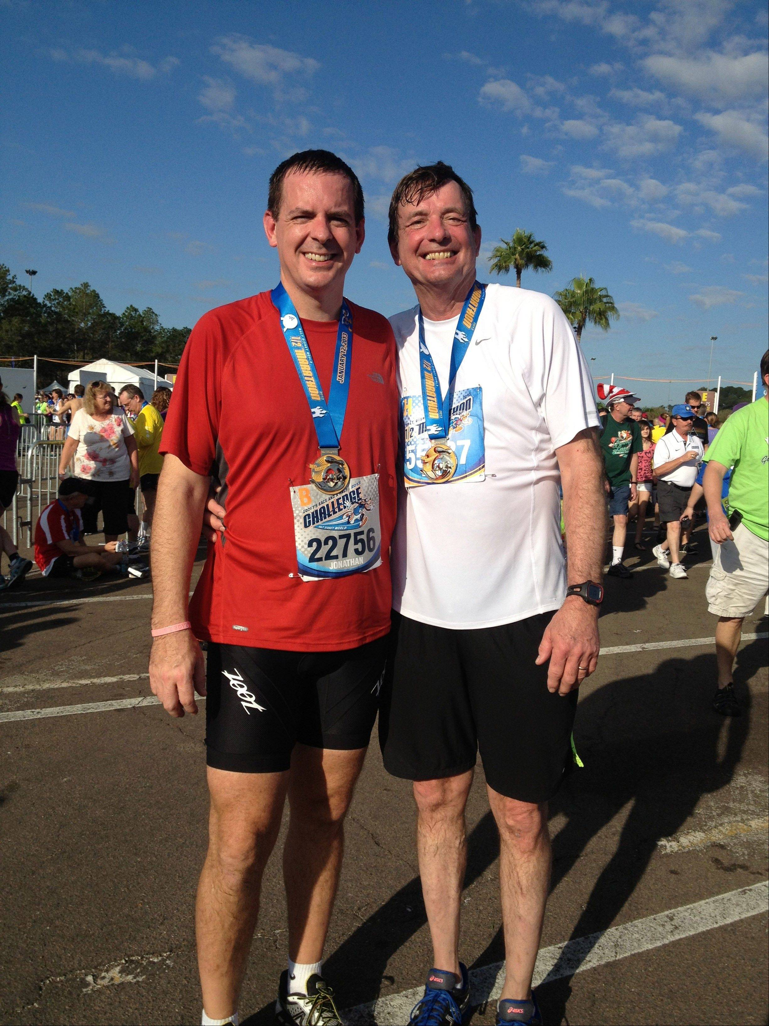 Associated Press/Jan. 12, 2013Doug Olson, right, and his son, Jon, stand together after running a half-marathon in Orlando, Fla. As of December 2013, Doug Olson, 67, a scientist for a medical device maker, shows no sign of cancer since gene therapy in September 2010 for chronic lymphocytic leukemia he found he had in 1996.