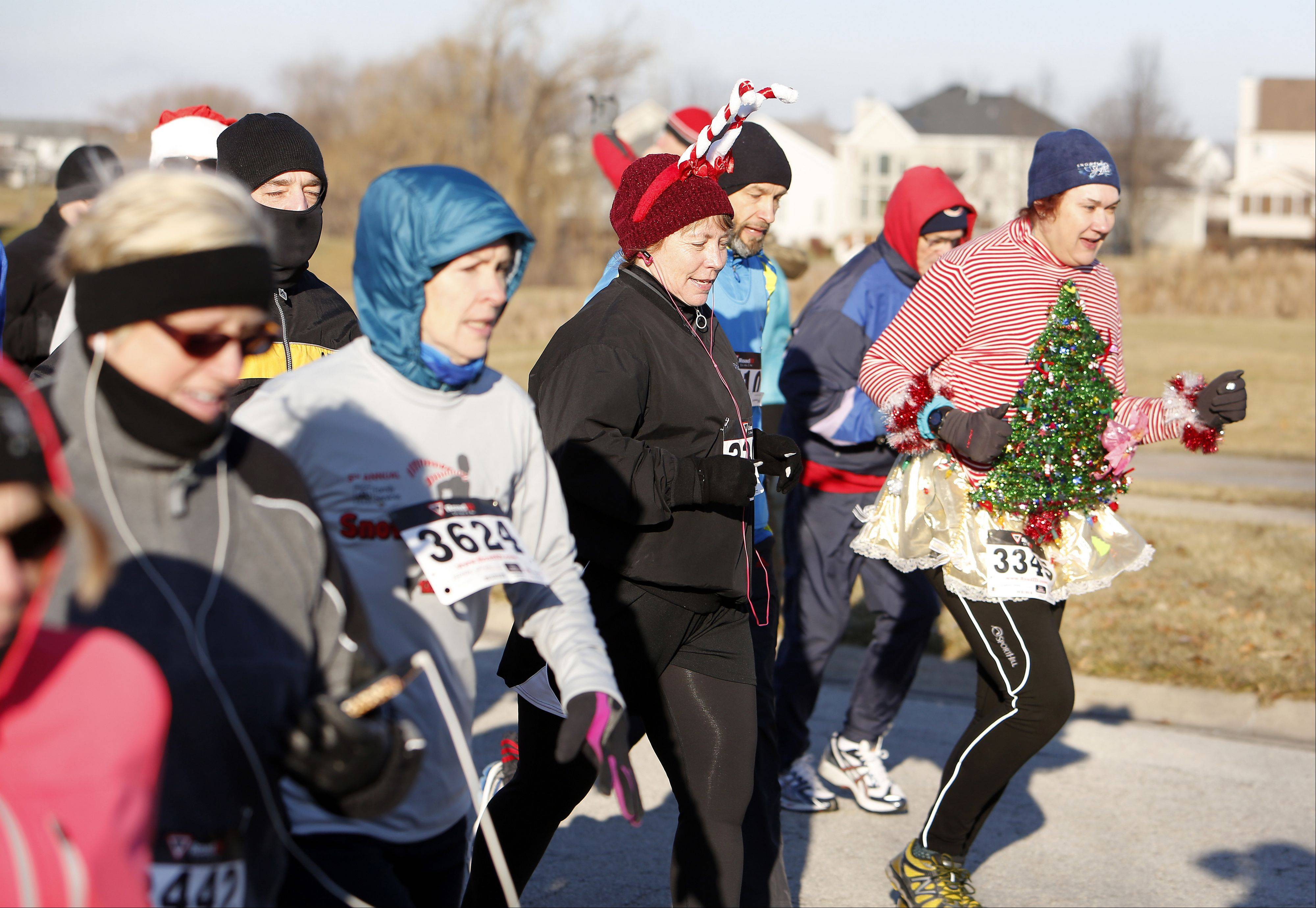 The 5K racers fight frigid weather during the TriCity Family Services' fifth annual Snowflake Shuffle Saturday in Geneva.