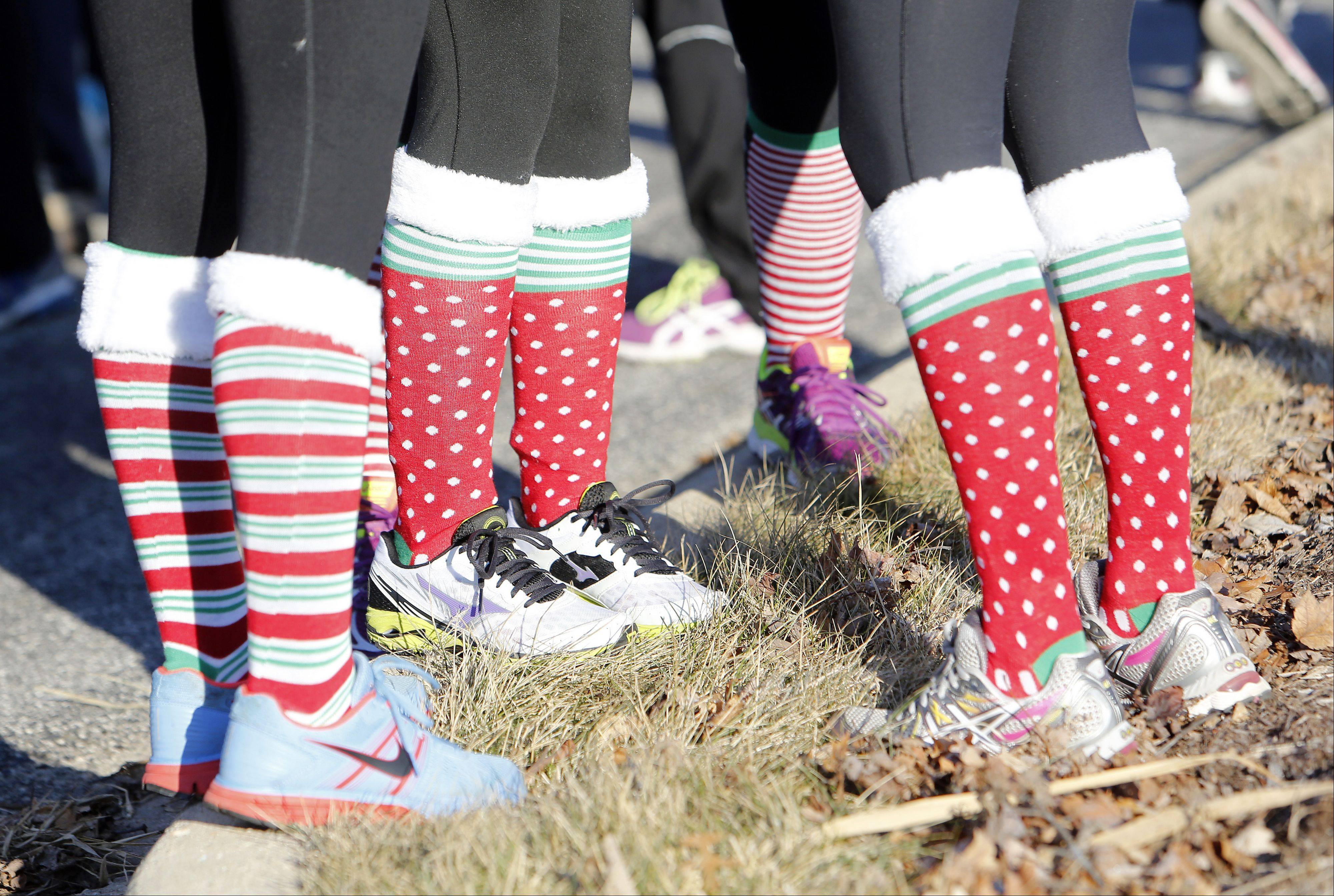 Runners donned Christmas socks as well as other decorations during the TriCity Family Services' fifth annual Snowflake Shuffle Saturday in Geneva.