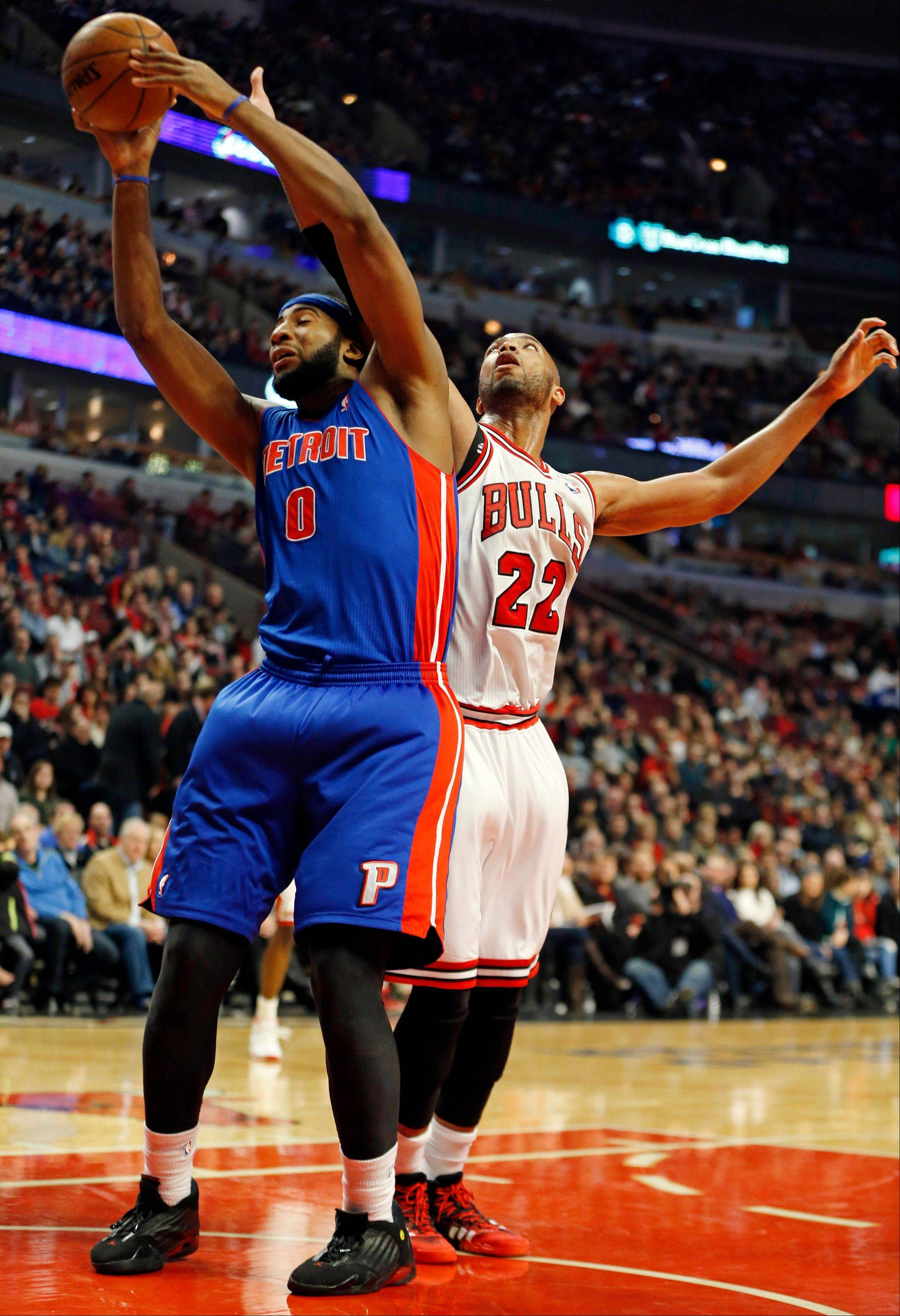 The Bulls' Taj Gibson puts some defensive pressure on Andre Drummond of the Pistons on Saturday at the United Center.