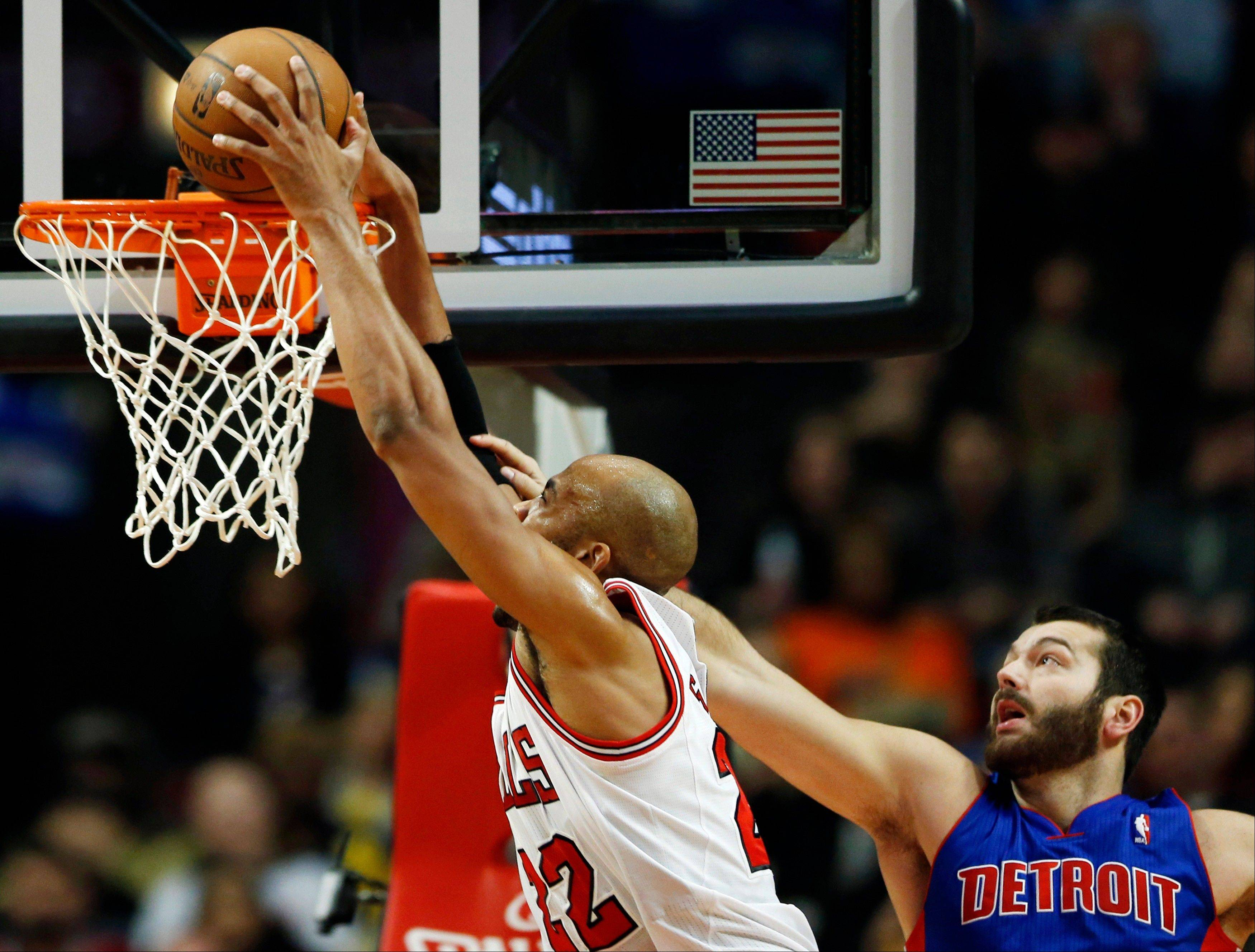 The Bulls' Taj Gibson gets fouled by the Pistons' Josh Harrellson on a drive to the basket Saturday at the United Center.