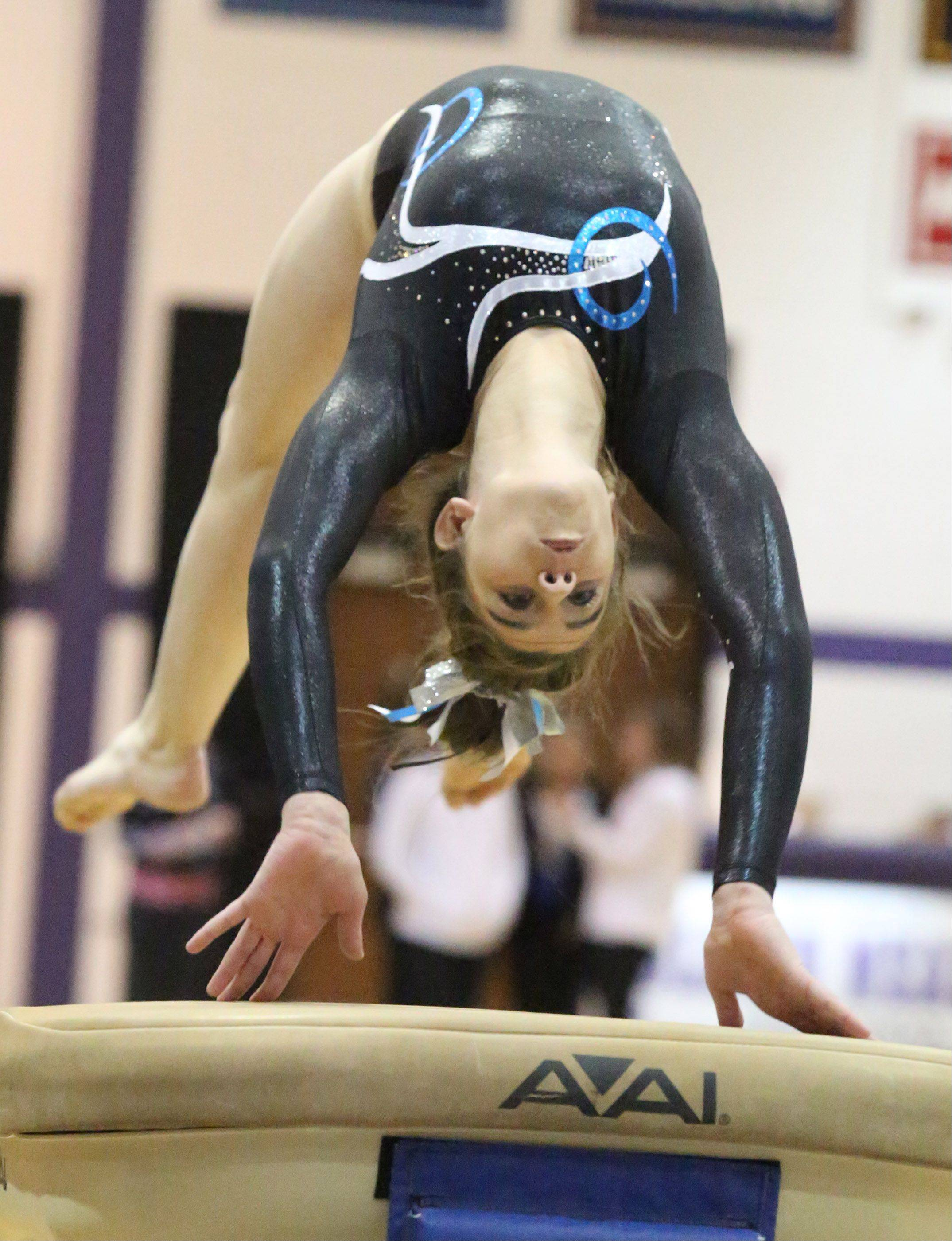 Prospect's Megan Schmit competes on the vault at the Rolling Meadows Al Galatte Invitational on Saturday.