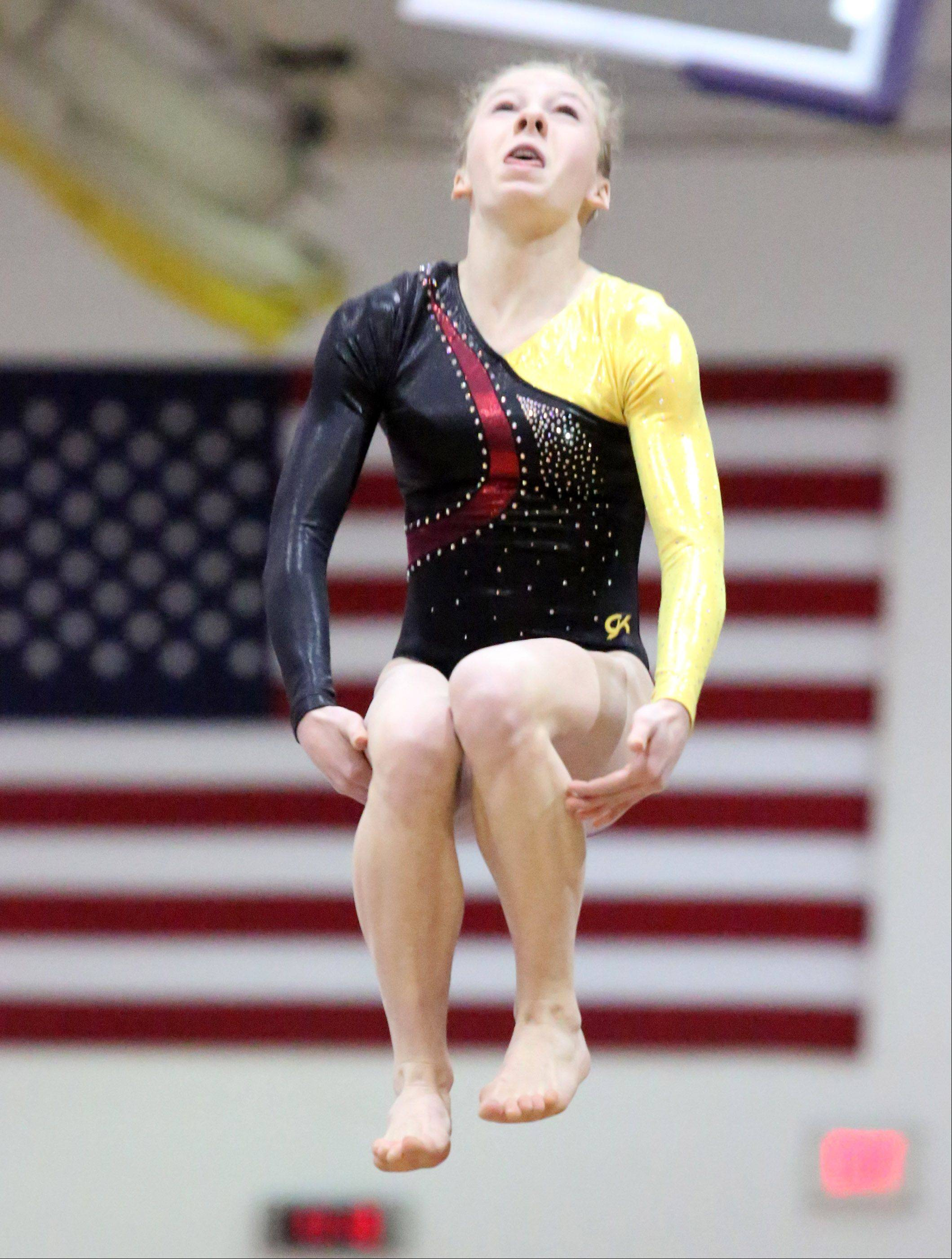 Schaumburg's Alyssa Kiszka competes on the vault at the Rolling Meadows Al Galatte Invitational on Saturday.