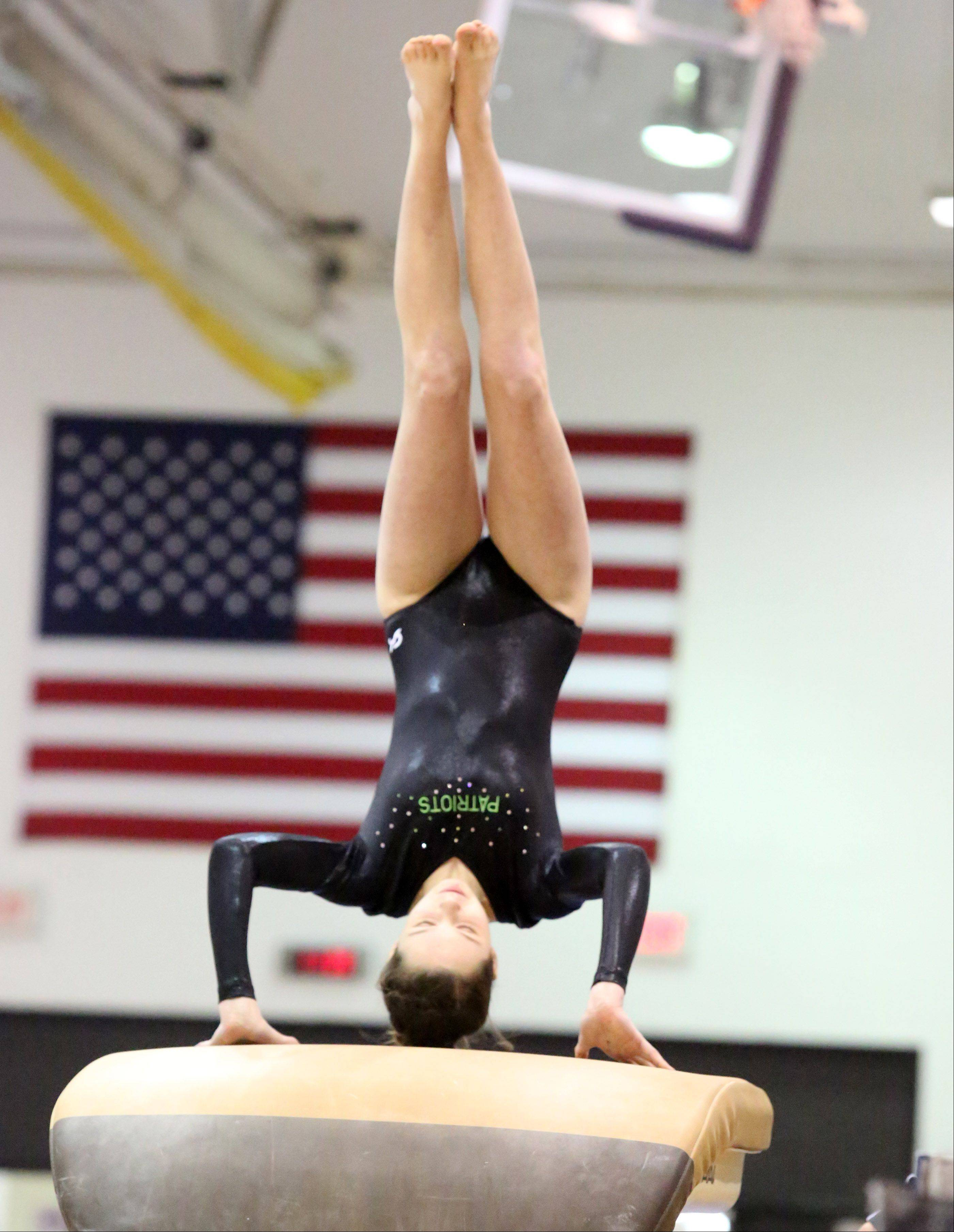 Stevenson's Natalie Schulman competes on the vault at the Rolling Meadows Al Galatte Invitational on Saturday.