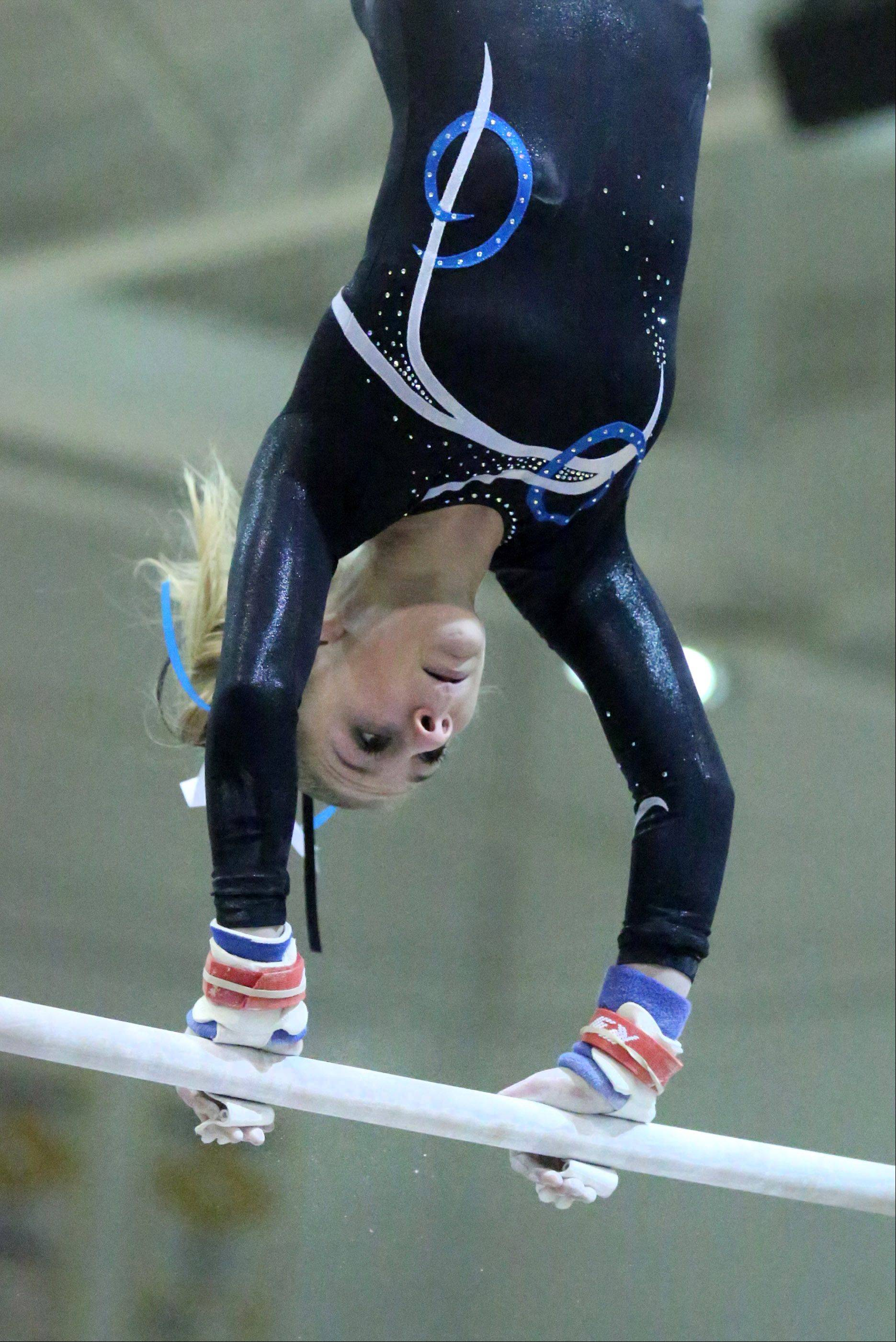 Prospect's Maddie Boldt competes on the uneven bars at the Rolling Meadows Al Galatte Invitational on Saturday.