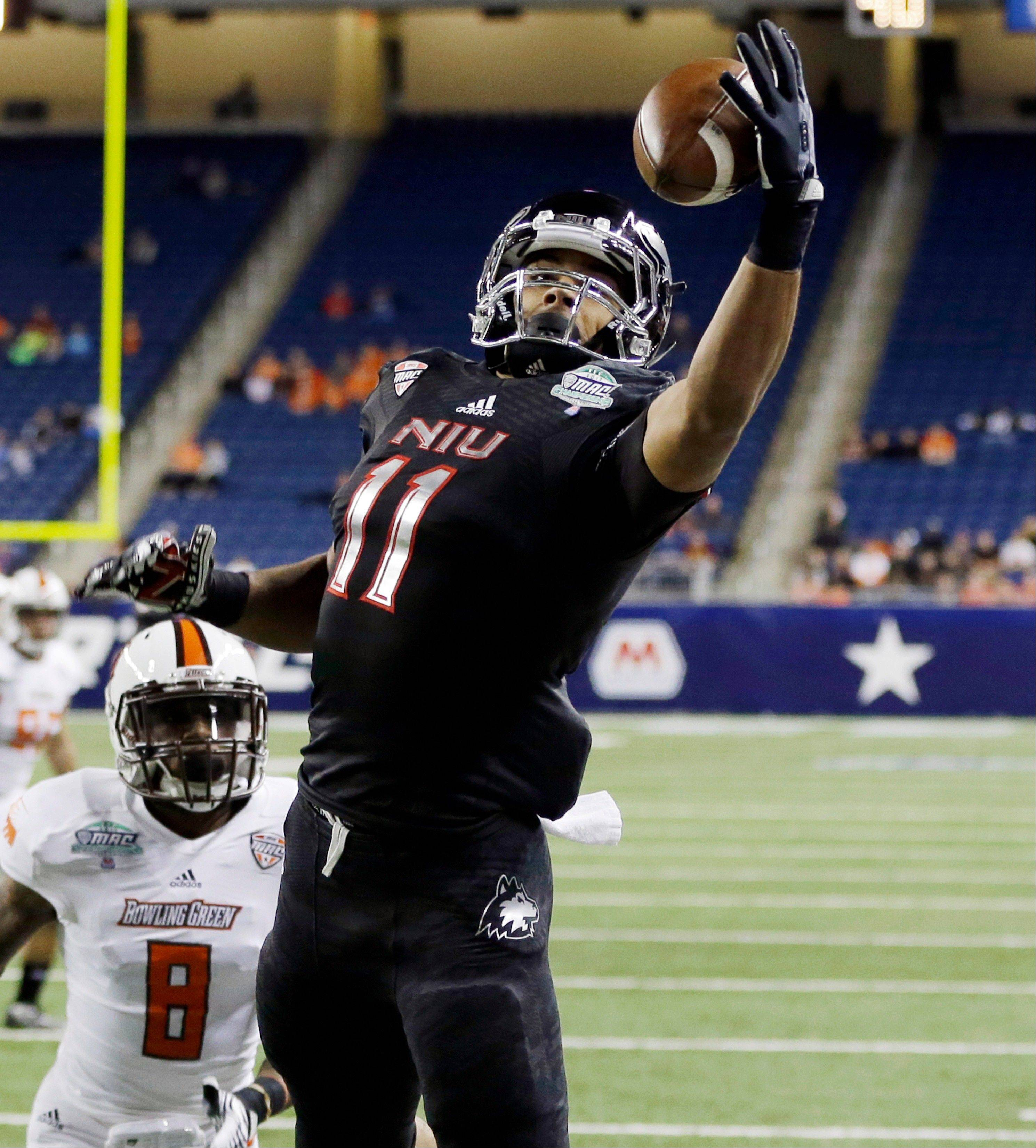 Northern Illinois wide receiver Juwan Brescacin (11) reaches for a 14-yard reception for a touchdown during the first quarter of the Mid-American Conference championship game in Detroit on Friday. NIU lost to Bowling Green 47-27.