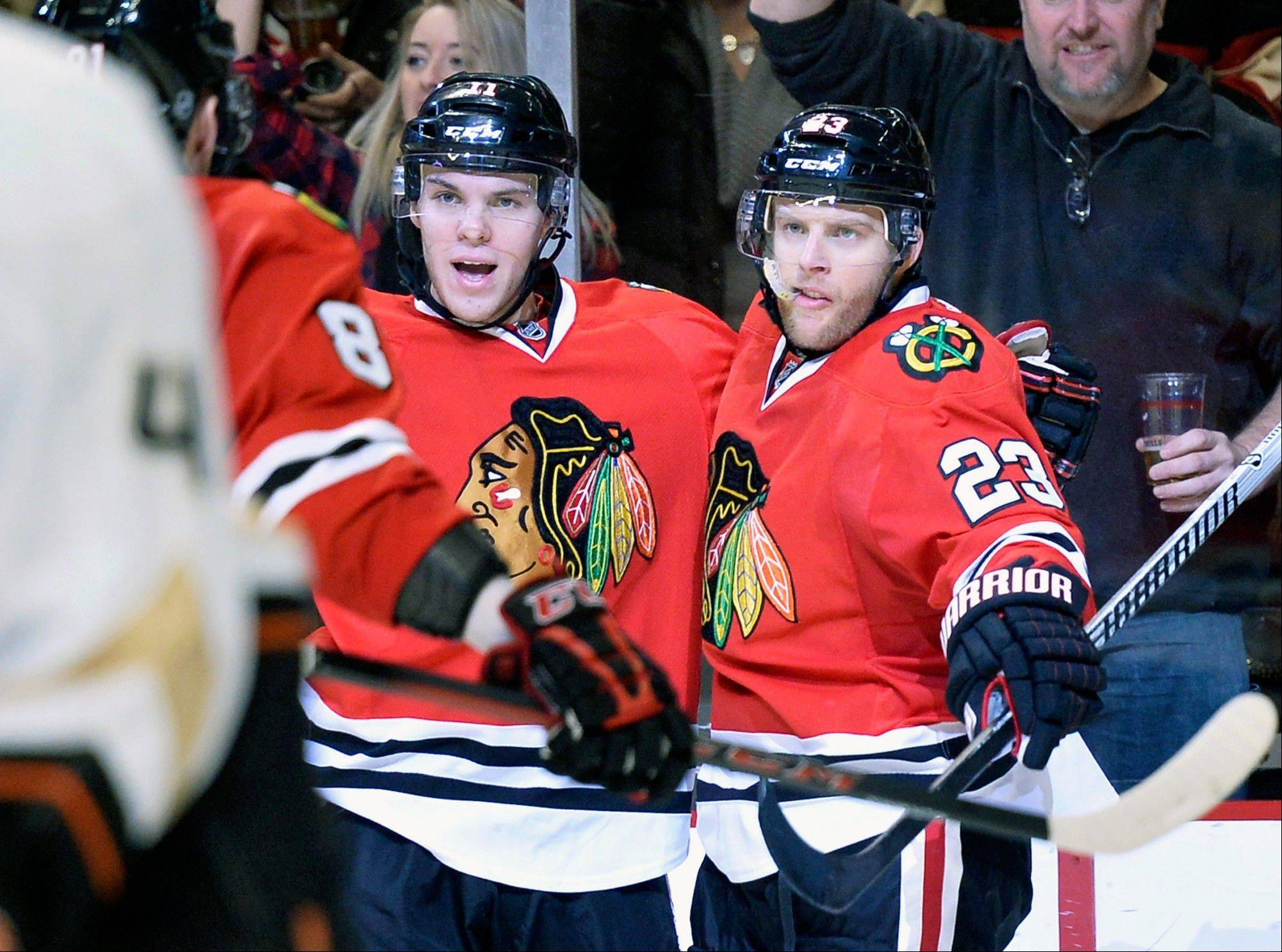 Blackhawks left wing Jeremy Morin, left, and right wing Kris Versteeg celebrate Versteeg's goal during the second period of an NHL hockey game against the Anaheim Ducks, Friday, Dec. 6, 2013, in Chicago.