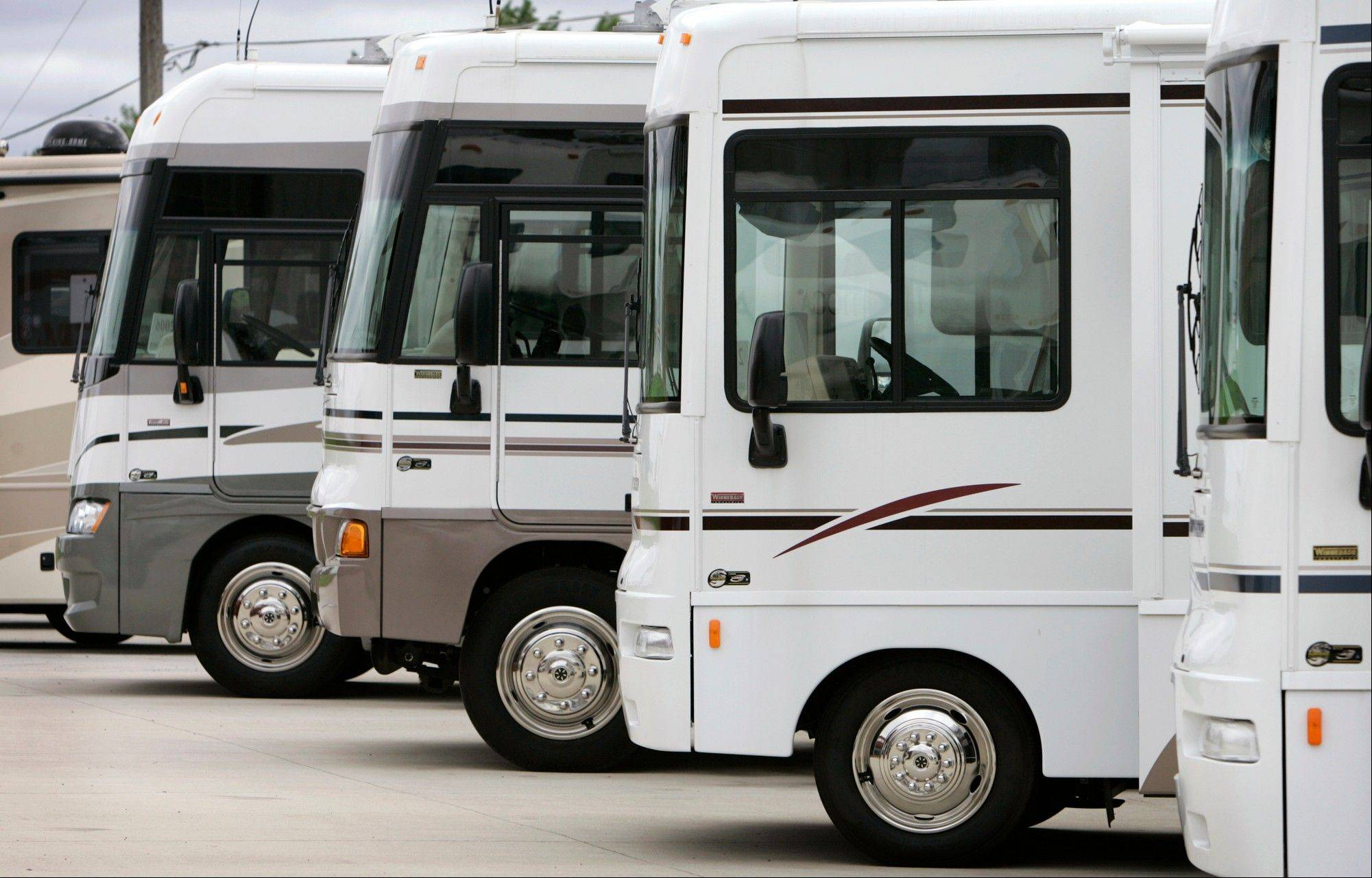 Winnebago motor homes are shown on a lot, in Jefferson, Iowa. Led by sales growth for towable RVs and pricier stand-alone motor homes, recreational vehicle makers expect to ship more than 300,000 units to dealers in 2013 for the first time since the economic downturn.