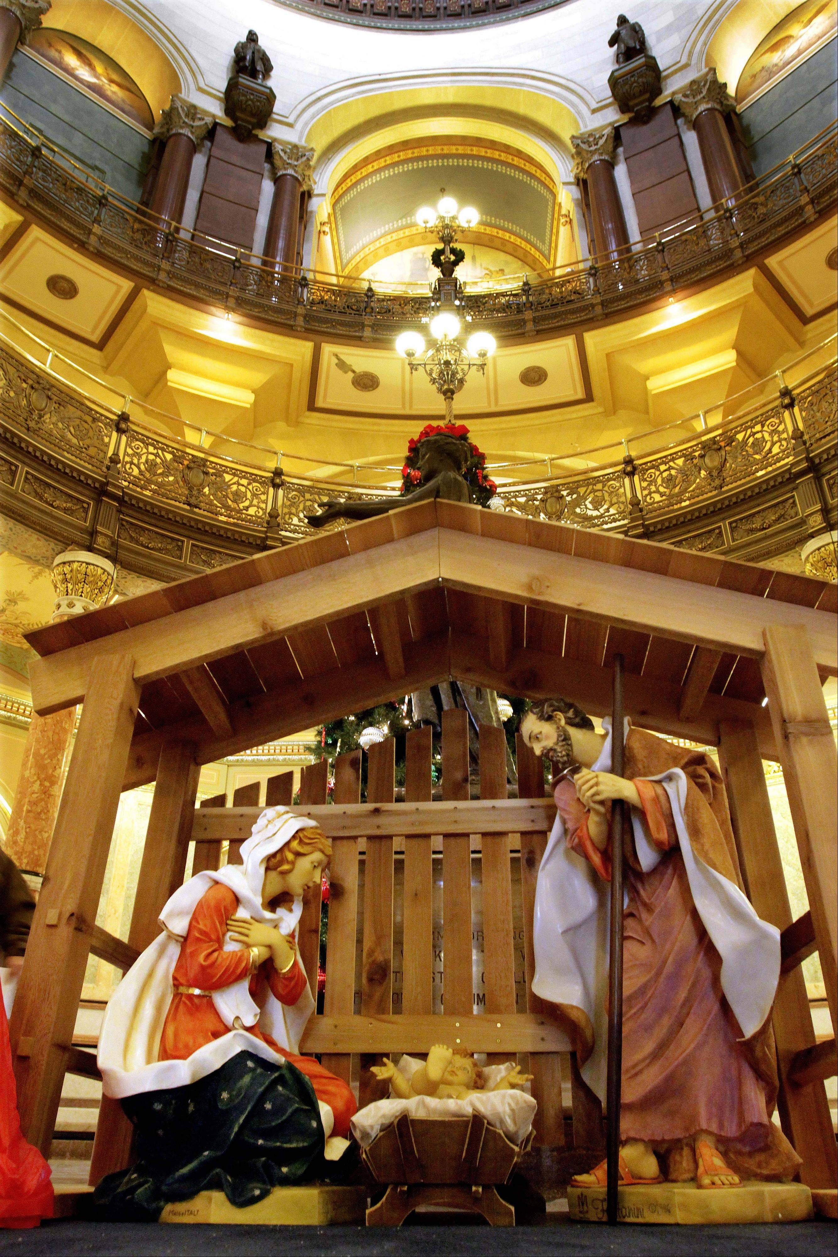 Associated Press A Nativity scene is displayed for the holiday season in the rotunda of the Illinois State Capitol in 2011 in Springfield.