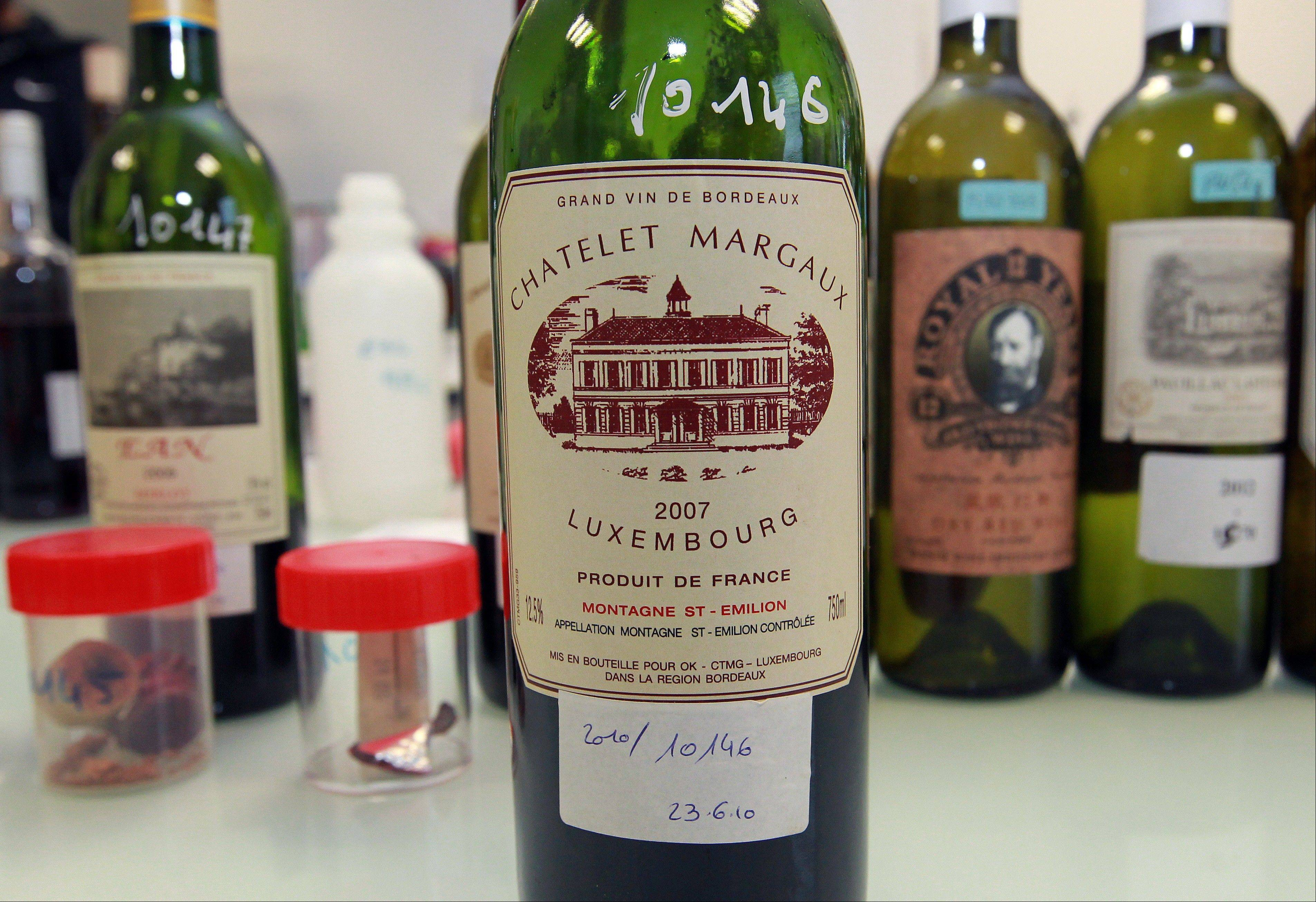 ASSOCIATED PRESS This is an example of a counterfeit bottle of wine displayed in a lab run by the French Finance ministry in Bordeaux, southwestern France. Counterfeiting has dogged wine as long as it has been produced, but it is getting more sophisticated and more ambitious.