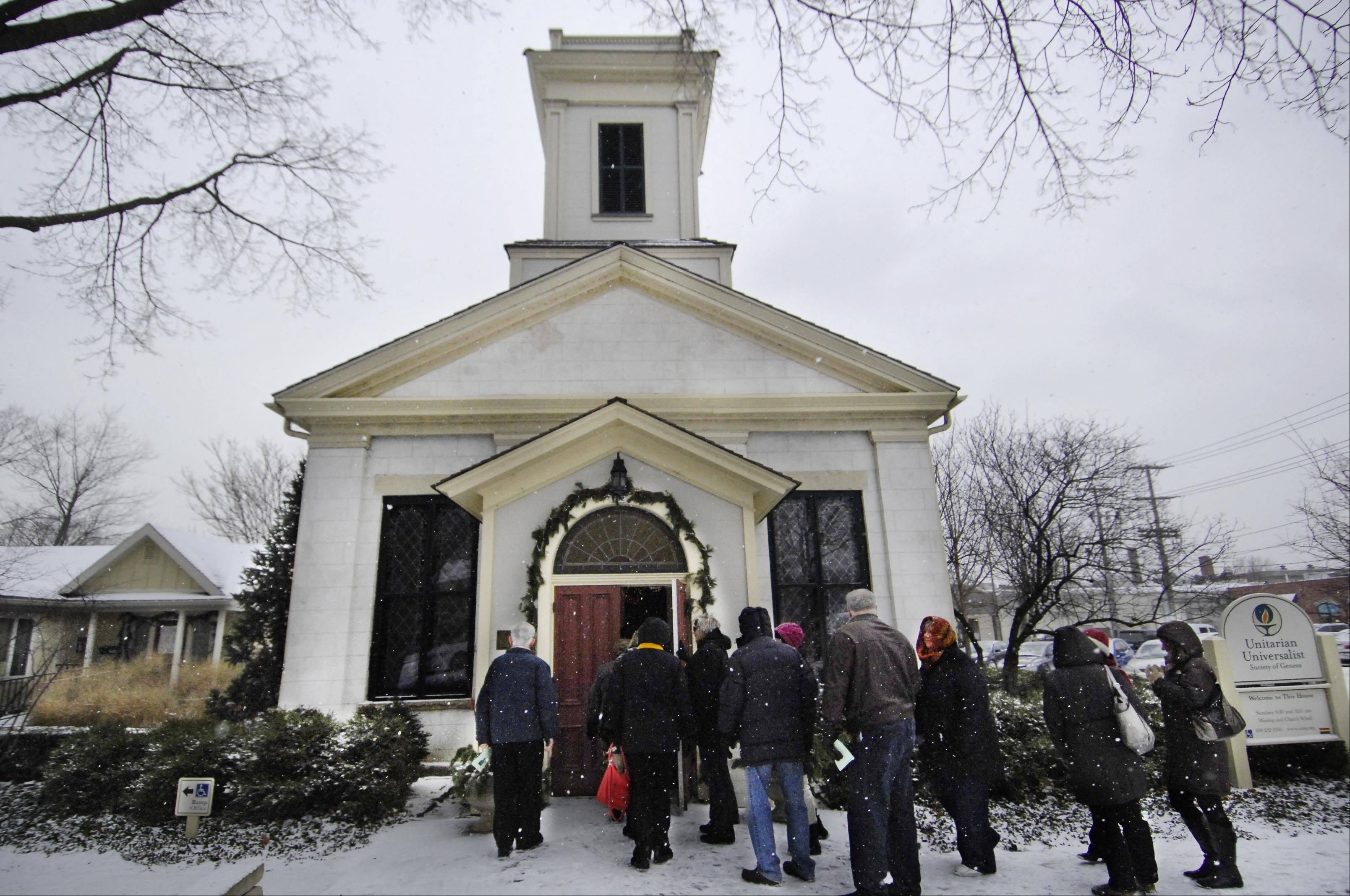 Visitors enter the oldest church in Geneva, the Unitarian Universalist Society, Sunday during the city's annual Steeple Walk. The Geneva Cultural Arts Commission sponsors the event, in which participants visit four city churches and enjoy musical performances at each.