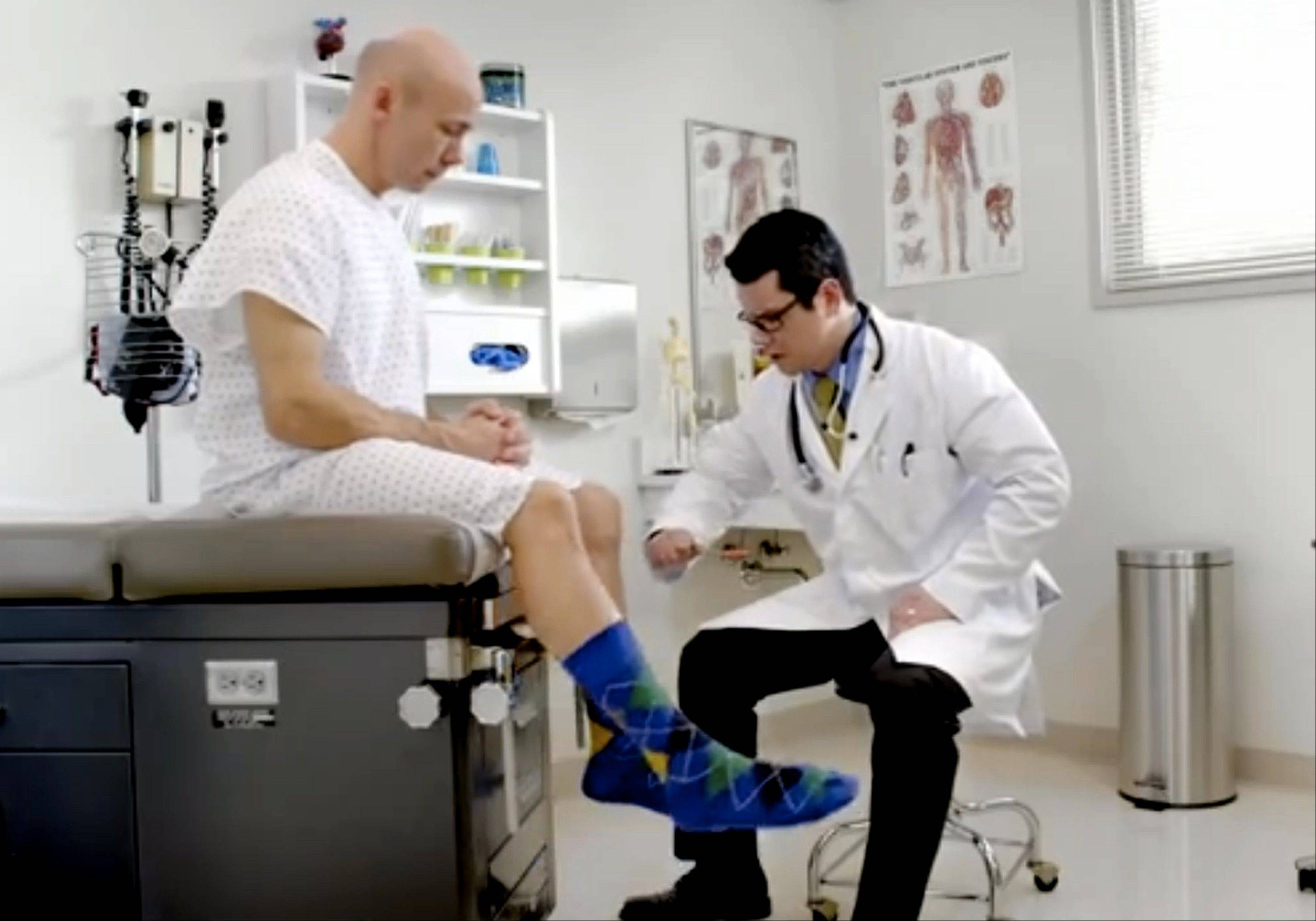 In this image from video provided by Wellmark Blue Cross and Blue Shield, a man kicks the wrong leg as a doctor checks his reflexes in an ad from the Midwestern insurer. Wellmark launched ads recently in Iowa and South Dakota poking fun at technical problems that have plagued the federal governmentís insurance enrollment website while trying to lure away some potential customers.