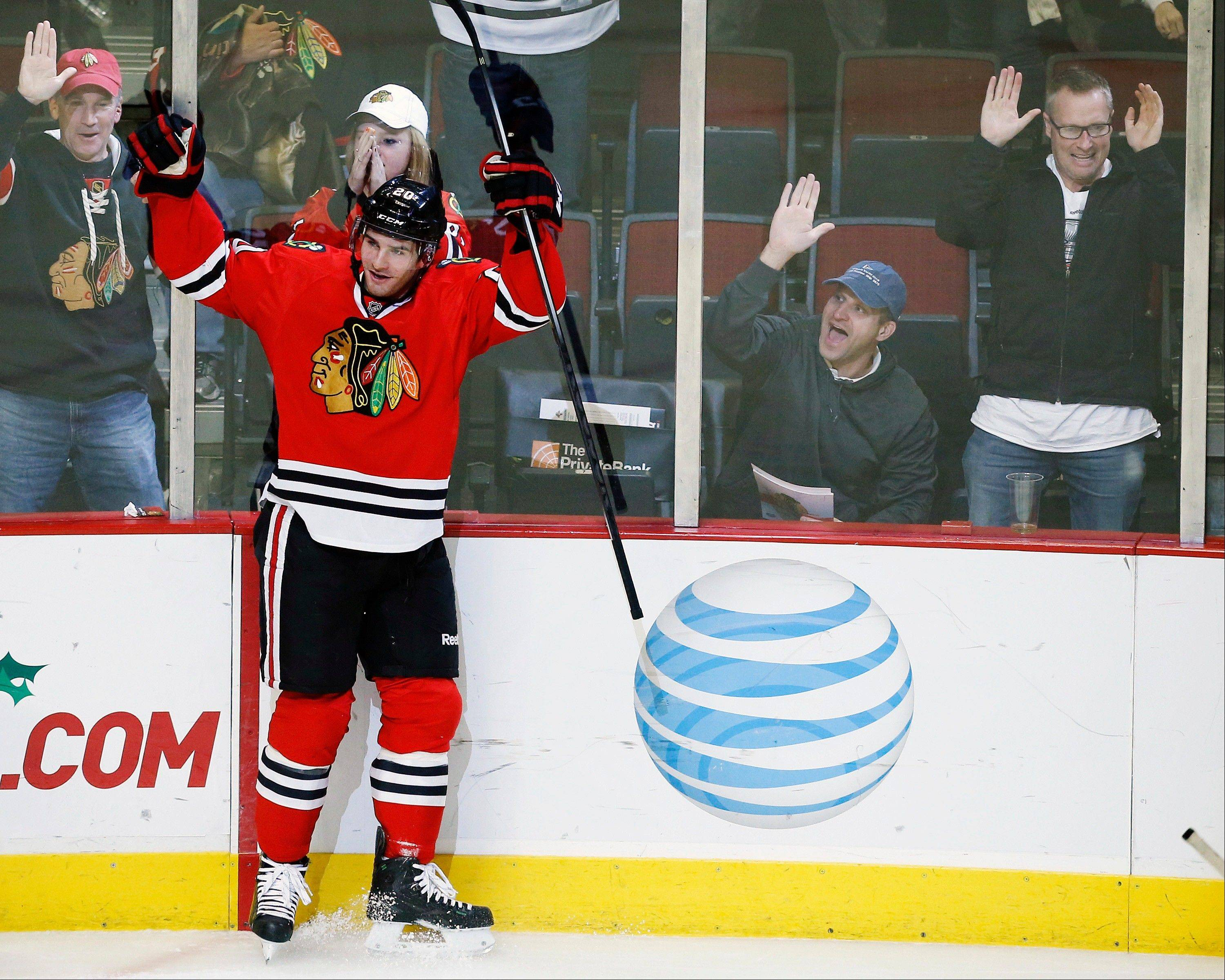 Blackhawks left wing Brandon Saad (20) celebrates scoring a goal against the Florida Panthers during the third period of an NHL hockey game on Sunday, Dec. 8, 2013, at United Center.